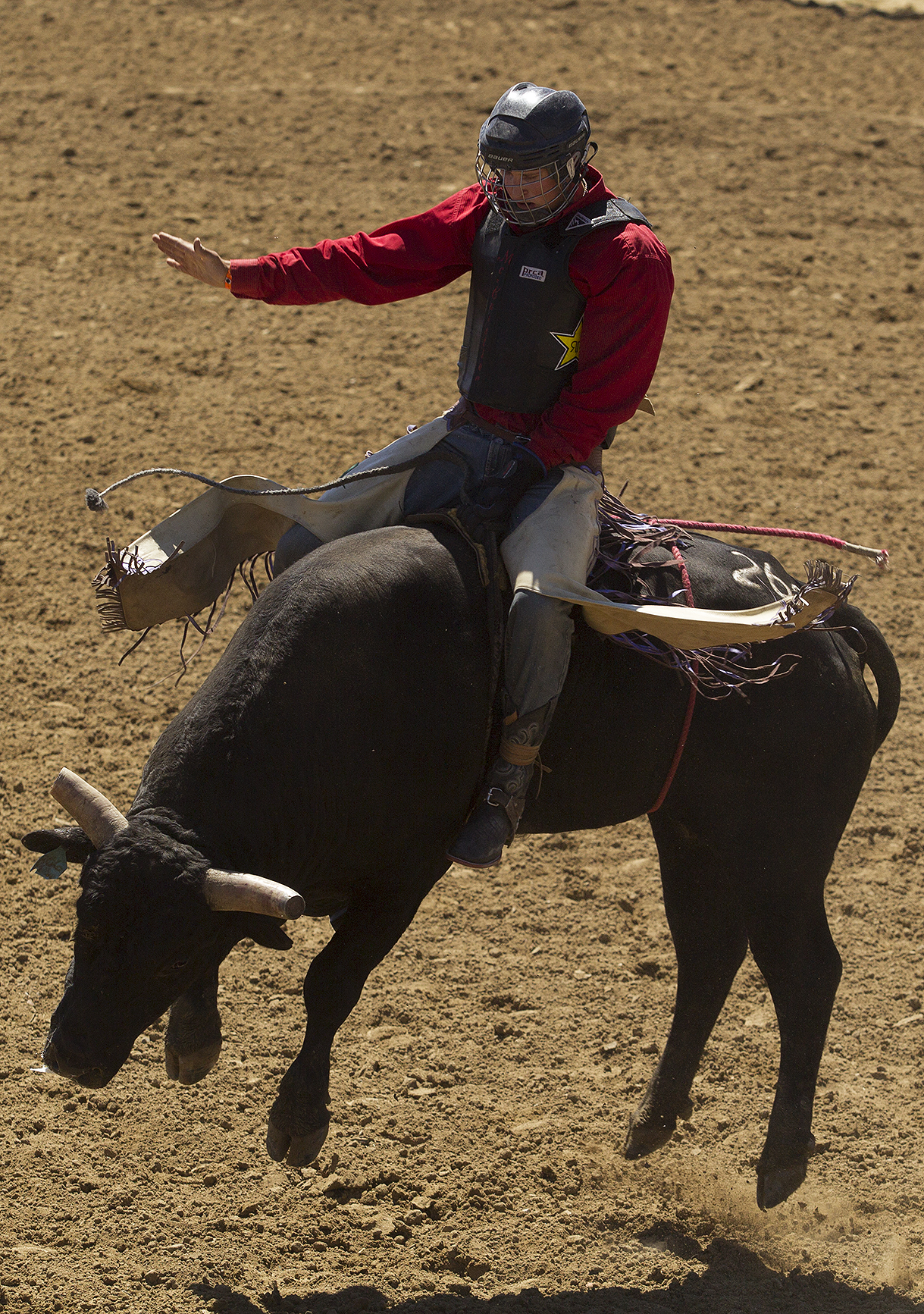 Yance McCuistion of Sugar City, Colo., rides a bull during Wednesday morning's performance of the 2016 National High School Finals Rodeo at Morningside Park.