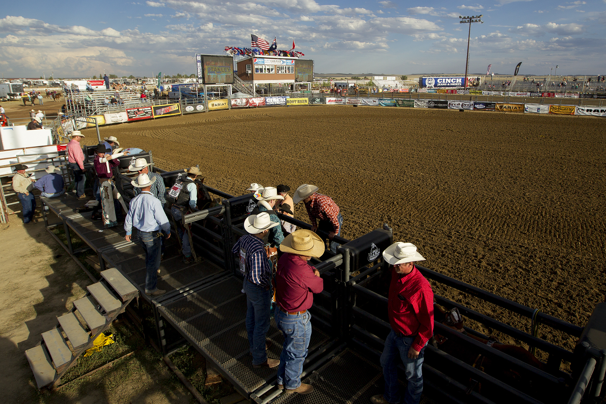 Bronc riders, along with friends and family, get ready for the Thursday evening performance of the 2016 National High School Finals Rodeo.