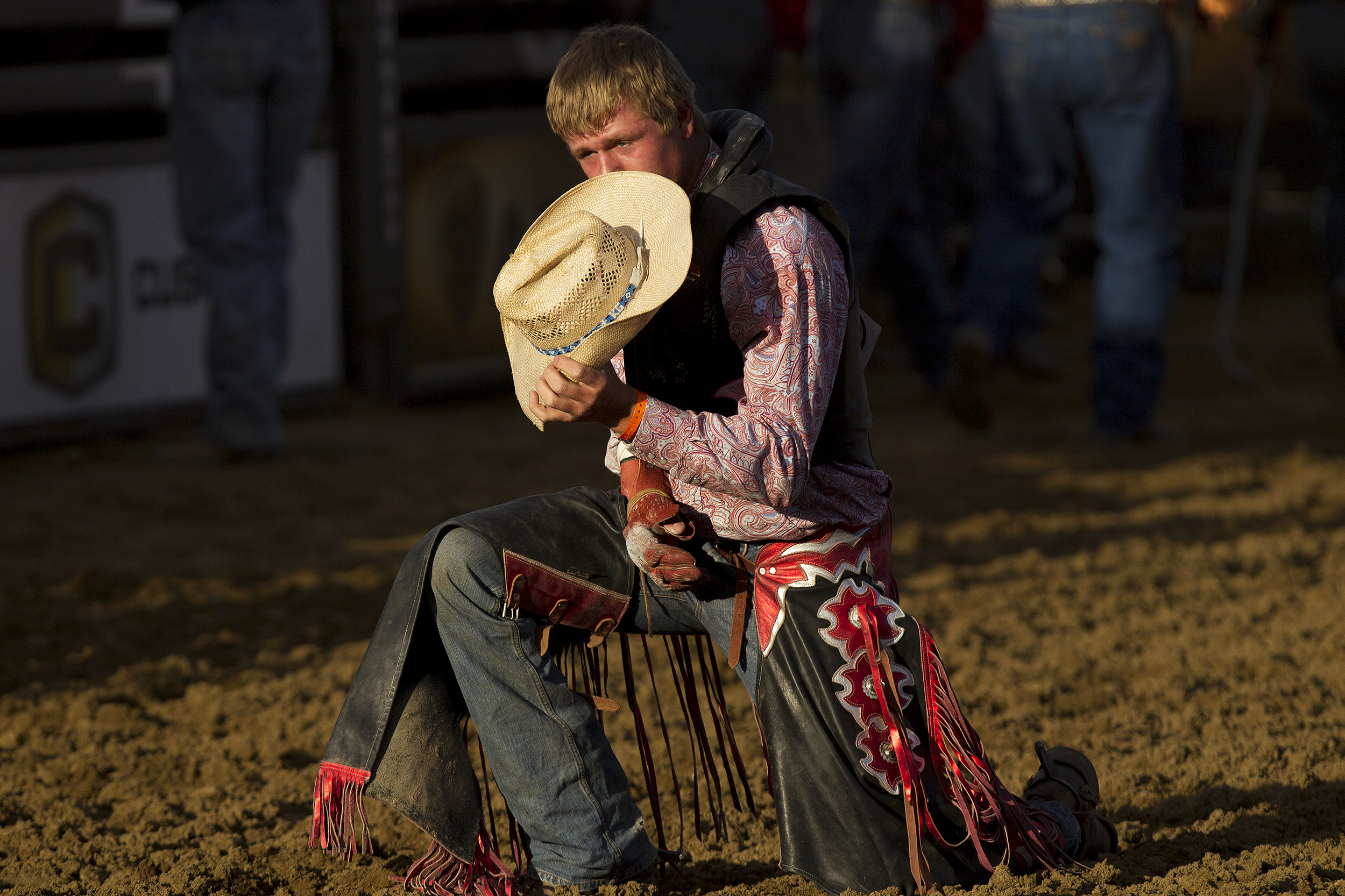 Kody Gregory of Cortez, Colo., prays after his bareback ride Thursday evening during the 2016 National High School Finals Rodeo at Cam-plex.