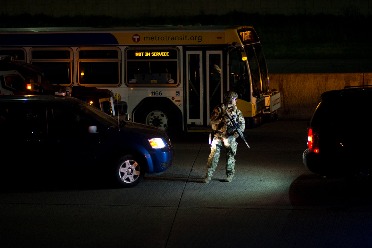 An armed officer stands on Interstate 95 in St. Paul as police break up a protest on the interstate on June 16, 2017. Protesters shut down the interstate after Jeronimo Yanez was found not guilty of second-degree manslaughter for the killing of Philando Castile in July 2016.