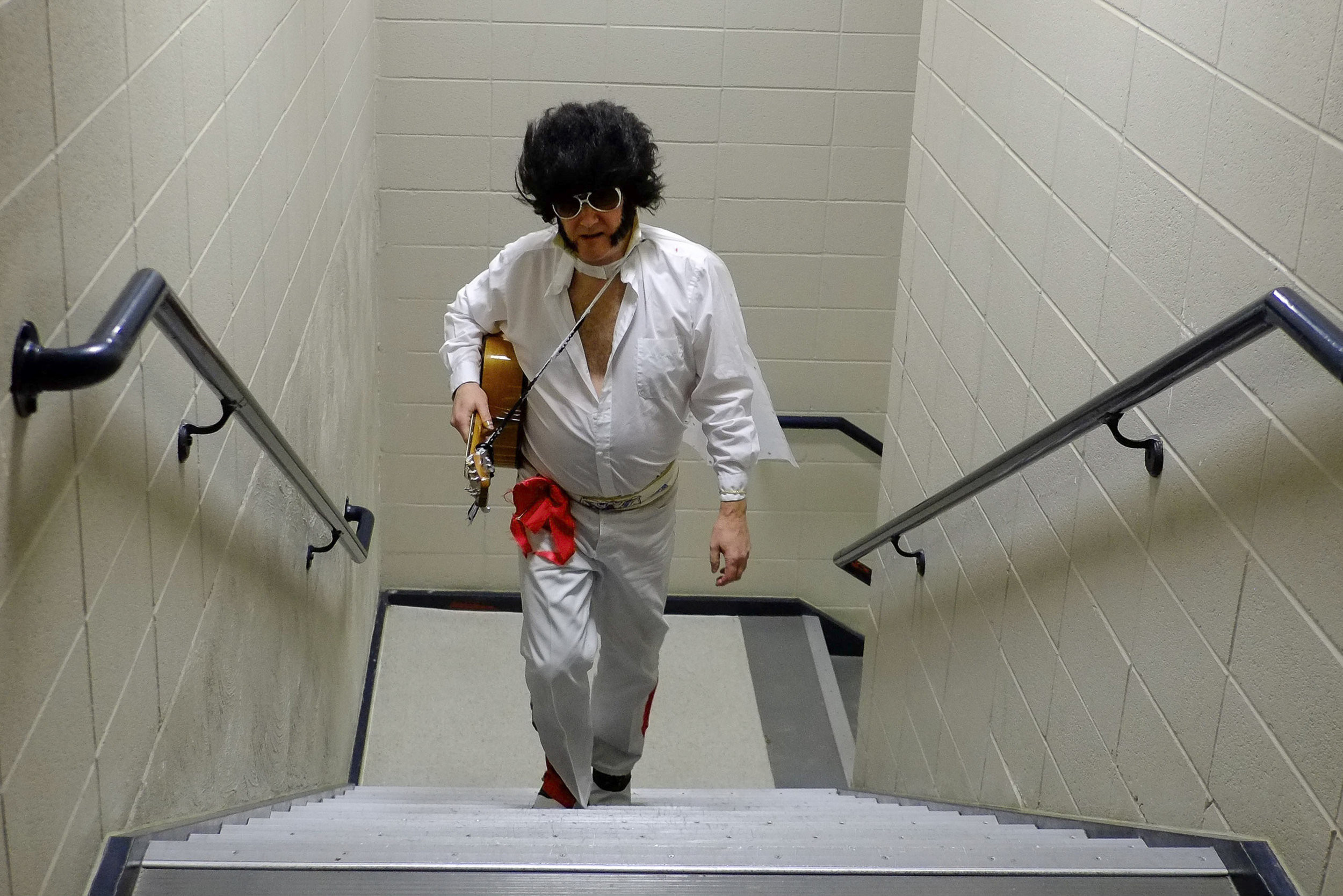 Jim Berman, dressed as Elvis, walks up the stairs at the Heritage Center Theater on Saturday March 1, 2016, after playing a song in the Gillette's Got Talent competition.