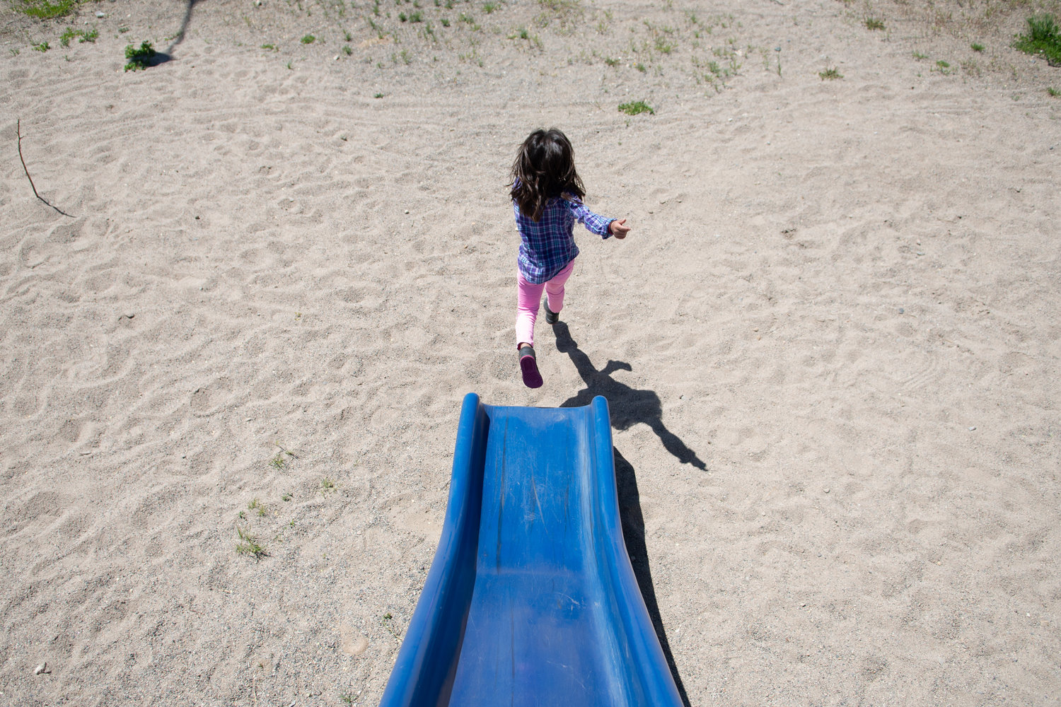 A student at the Crowheart School in Crowheart, Wyoming, jumps off the slider during recess on May 31, 2016. Crowheart is located in Fremont County School District No. 6, which covers 1,300 square miles and contains no licensed day care facilities, medical service providers or private pre-schools.