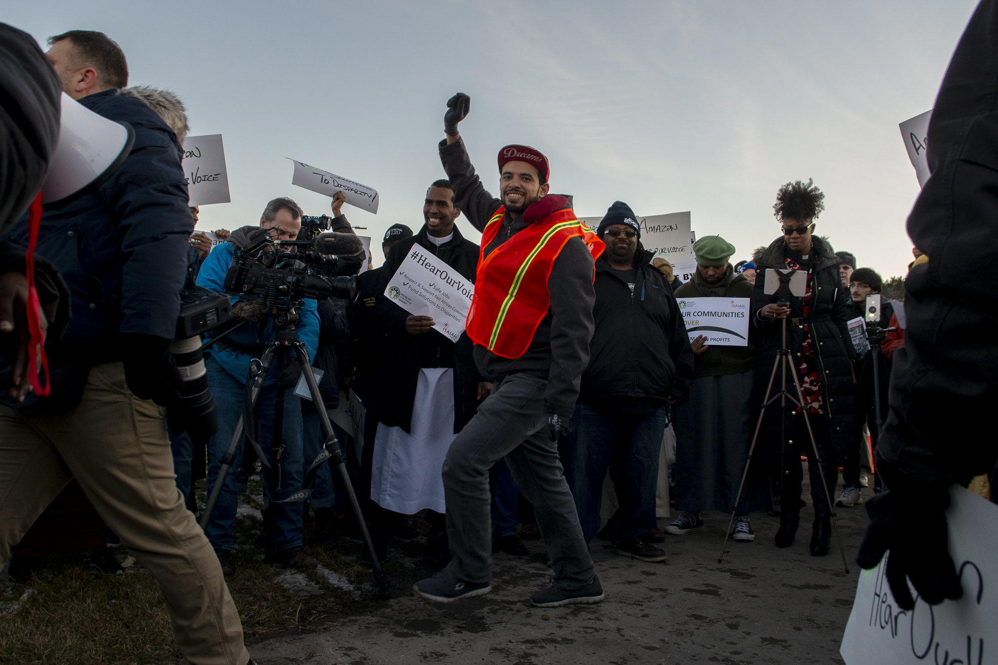 A man dances in the crowd during a protest at MSP-1, the Amazon fulfillment center in Shakopee, Minnesota, on December 14, 2018. Workers at the warehouse have been fighting amazon for better conditions, including reduced speed quotas and better safety regulations.