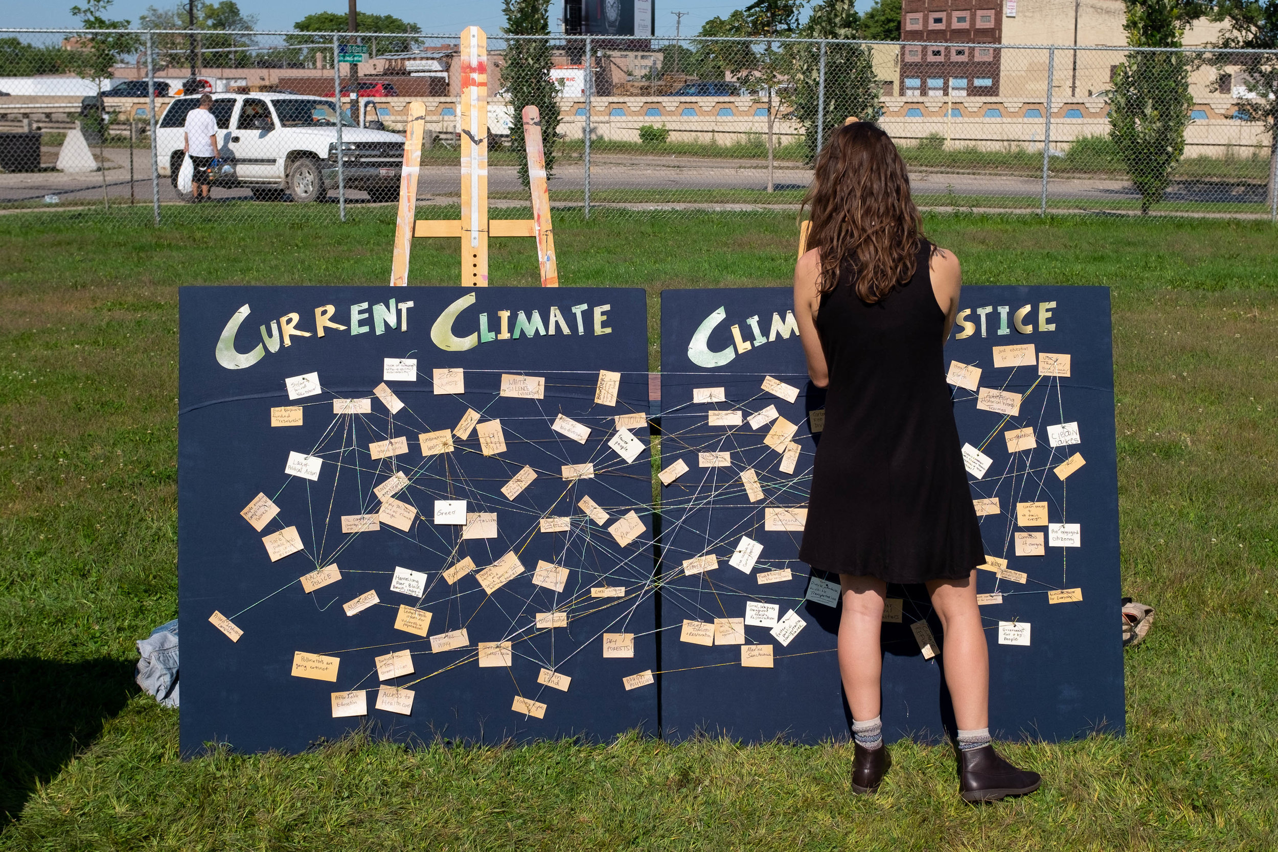A woman interacts with a display at a climate change summit at East Phillips Park in Minneapolis on September 8, 2019.