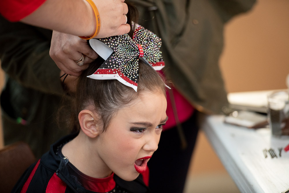 A student at TK's Gymnastics lets out a yell while getting her hair done on October 27, 2018 in Mount Sterling, Kentucky.