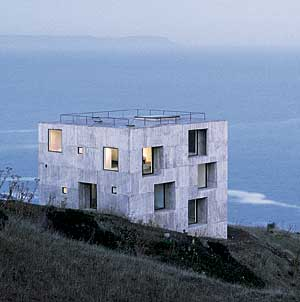 CASA POLI  - This geometrical flexible house appears like a rock within nature.