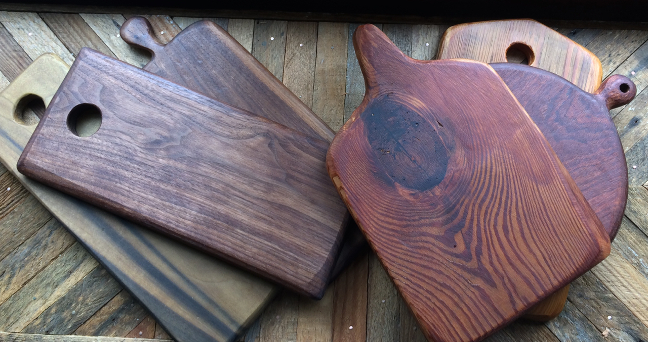 Serving boards with hand-carved edges and handles.