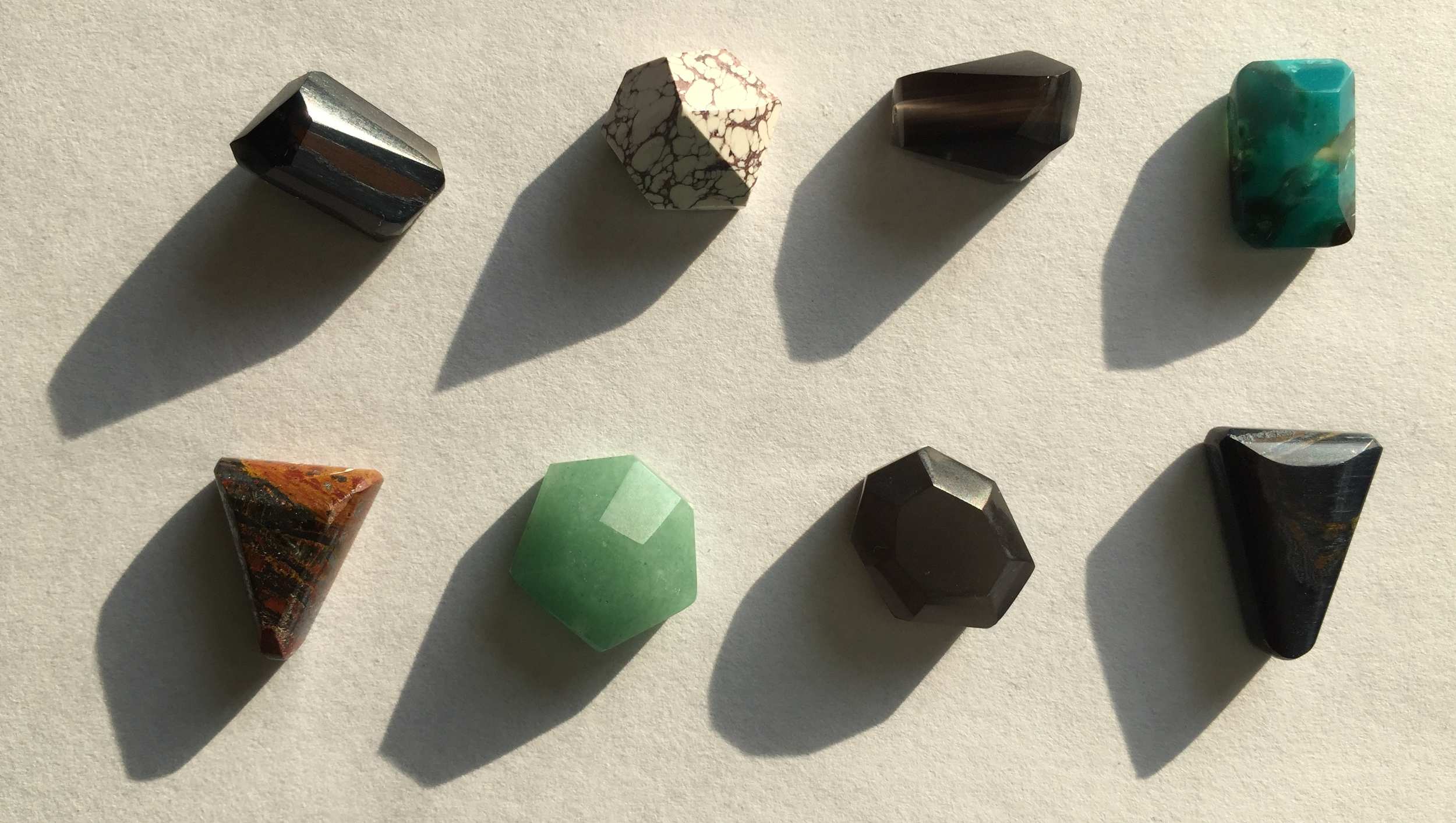 some recent stones that have been hand formed and faceted .