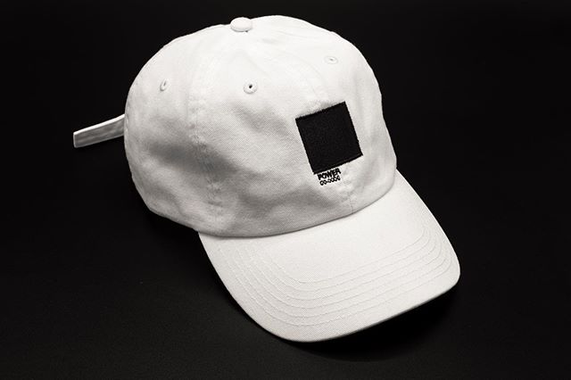 Black Power Pantone 00-0000  Black is associated with power, fear, mystery, strength, authority, elegance, formality, death, evil, and aggression, authority, rebellion, and sophistication. Black is required for all other colors to have depth and variation of hue.  Embroidered on Champion Dad Hat  Up in the shop...