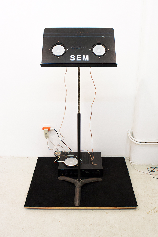 Tom Kotik   Untitled for Jan , 2009 music stand, cd player, sound system, platform 55 x 28 x 36 inches