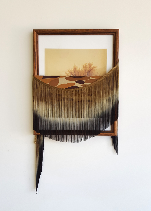 "Megan Mueller,  A Pretender of Dead Leaves, Found frame and print, neoprene, fringe, 15"" x 8"""