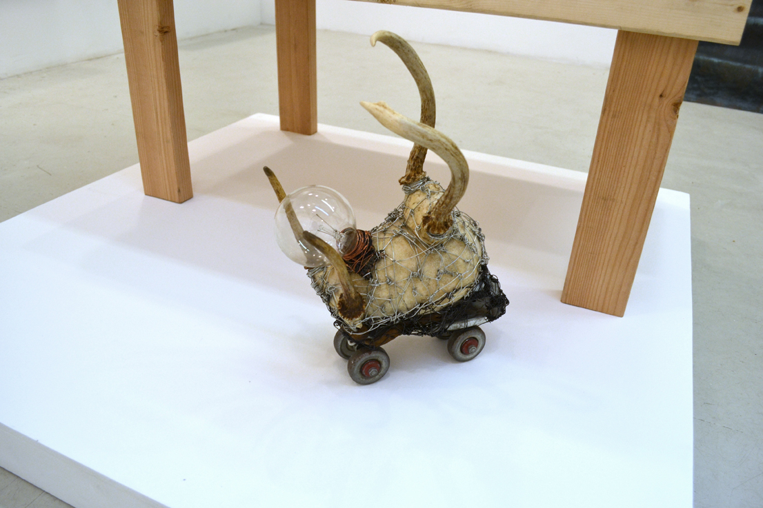 Arthur Simms, Beattle, 2015,  Horns, wire, light bulb, roller skate, rock, and leather 15 x 12 x 7""