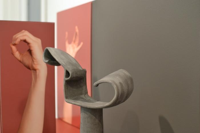"Ellie Krakow ""Arm Armature #2"" (detail), 2016 Glazed ceramic, photographs on aluminum, and wood"