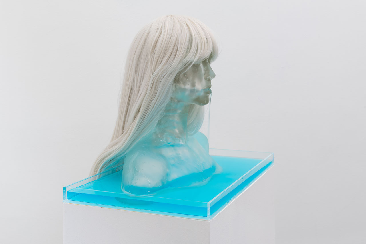 "Emily Endo /  Water Baby Fountain  / 2019 / Cast glass, synthetic hair, acrylic, aquarium pump, dyed water scented with flowers and salt / 58.5"" x 20"" x 16"" /  www.emilyendo.com"