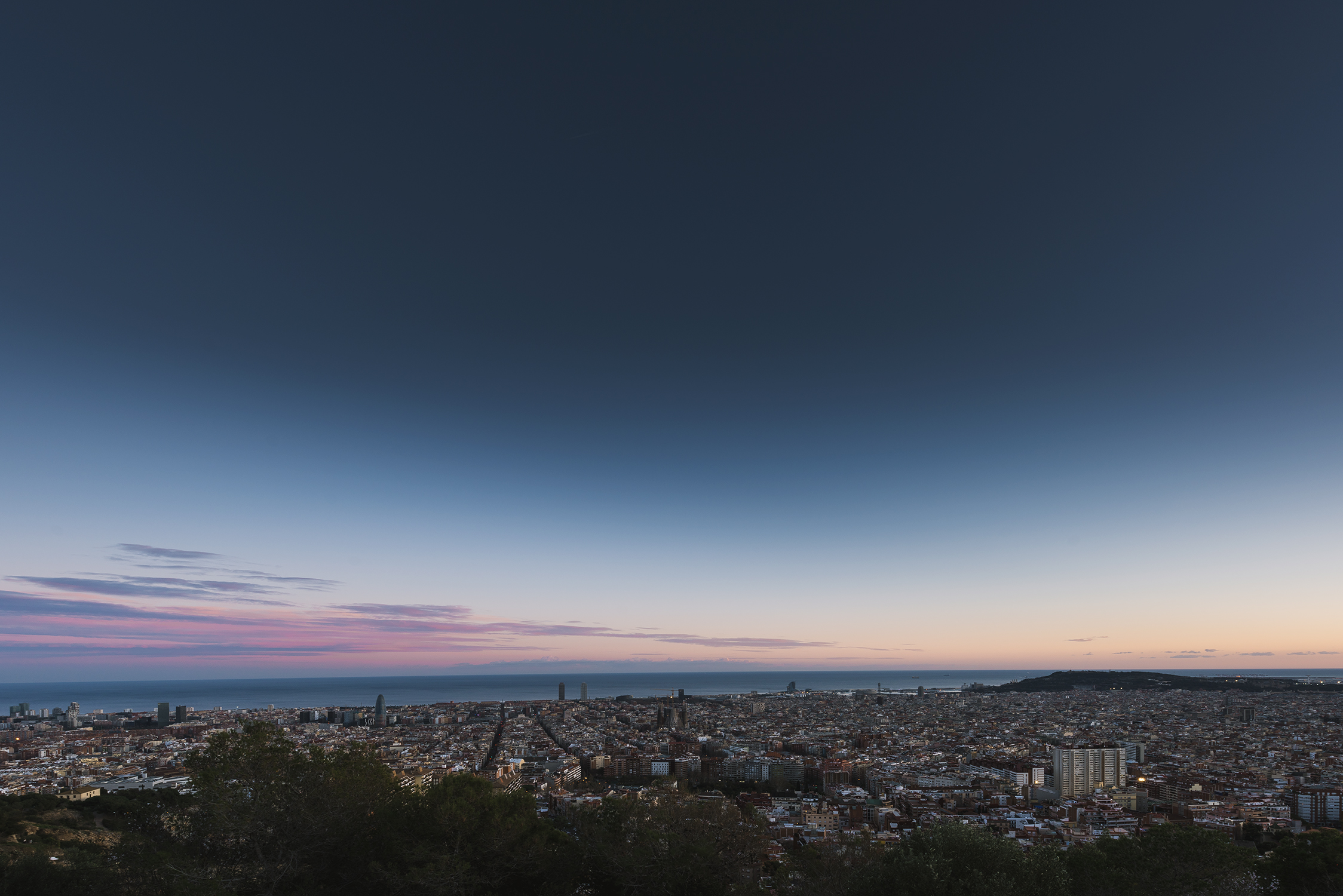 VIEW FROM BUNKERS DEL CARMEL, BARCELONA   Still can't get enough of this view �� even on a Saturday afternoon when it's full, there is still enough skyline for everyone!  #barcelona   #spain  #españa   #mondaymotivation  .  BASIC SETTINGS  CAMERA - Nikon D810 LENS - 14 - 24 mm f/2.8 FOCAL LENGTH - 14mm EXPOSURE - 1/6 sec f/11 ISO 64 TRIPOD & REMOTE SHUTTER  The sun sets over to the right out of frame, behind Tibidabo but for me the sky out to sea usually shows the most beautiful colours. Saturday was kind of peaceful and only some colours shone through but what better way to spend a Saturday afternoon!?  FIND BUNKERS FOR YOURSELF IF YOUR EVER IN BARCELONA -  http://bit.ly/2nEV0U7