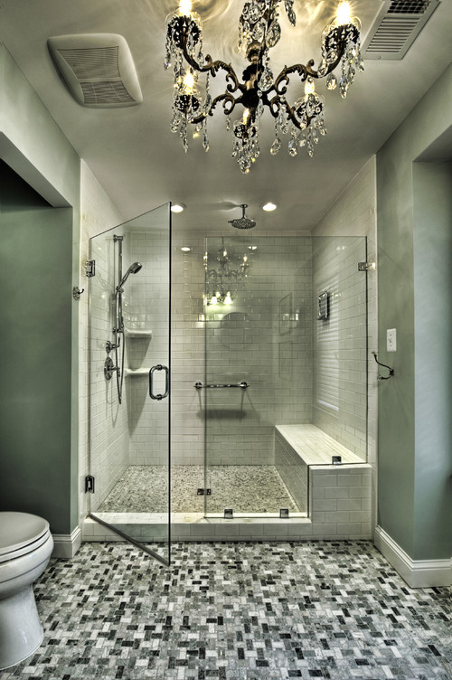White-tile-shower-to-ceiling-with-interesting-tiling-floor-and-glass-doors-then-unique-chandelier.jpg