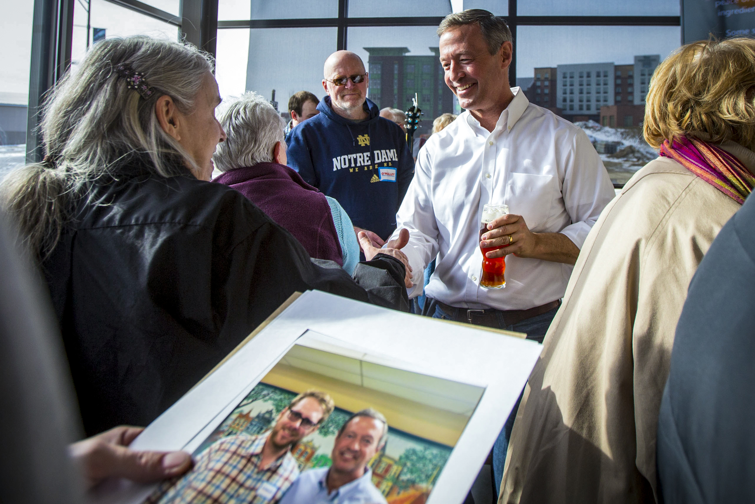 """Presidential candidate Martin O'Malley shakes hands and meets guests after speaking at Backpocket Brewing in Coralville, Illinois, Saturday Jan. 23, 2016. The former Maryland governor made a stop as a part of """"O'Malley Unplugged: The New Leadership Tour"""" with only nine days left until the Iowa Caucus."""