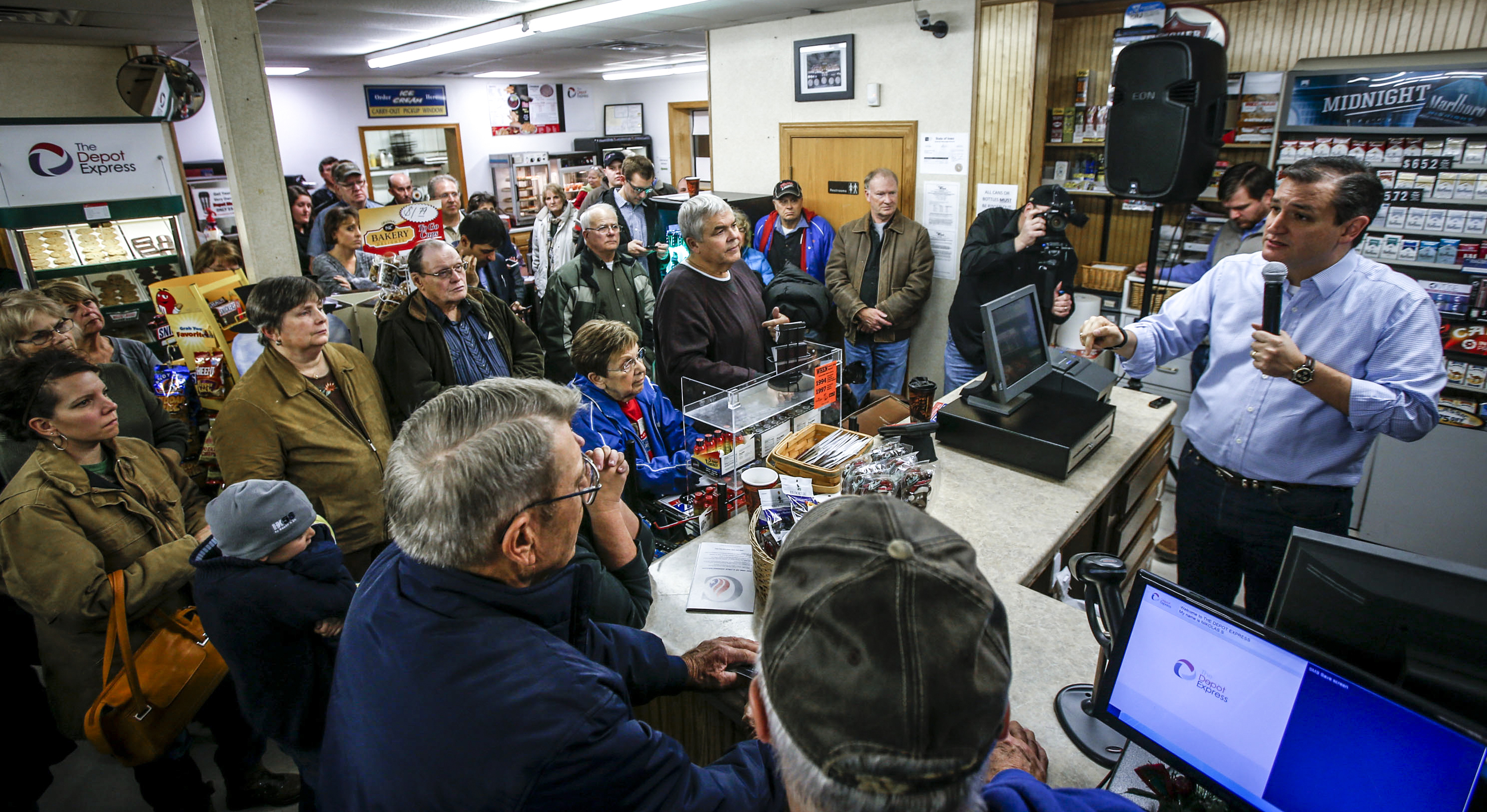 Sen. Ted Cruz speaks to a crowd packed in the Depot Express gas station in Van Horne, Iowa, Sunday, Nov. 29, 2015. The presidential hopeful made a stop at the Depot Express gas station to give a speech and answer questions with gathered community members and supporters.