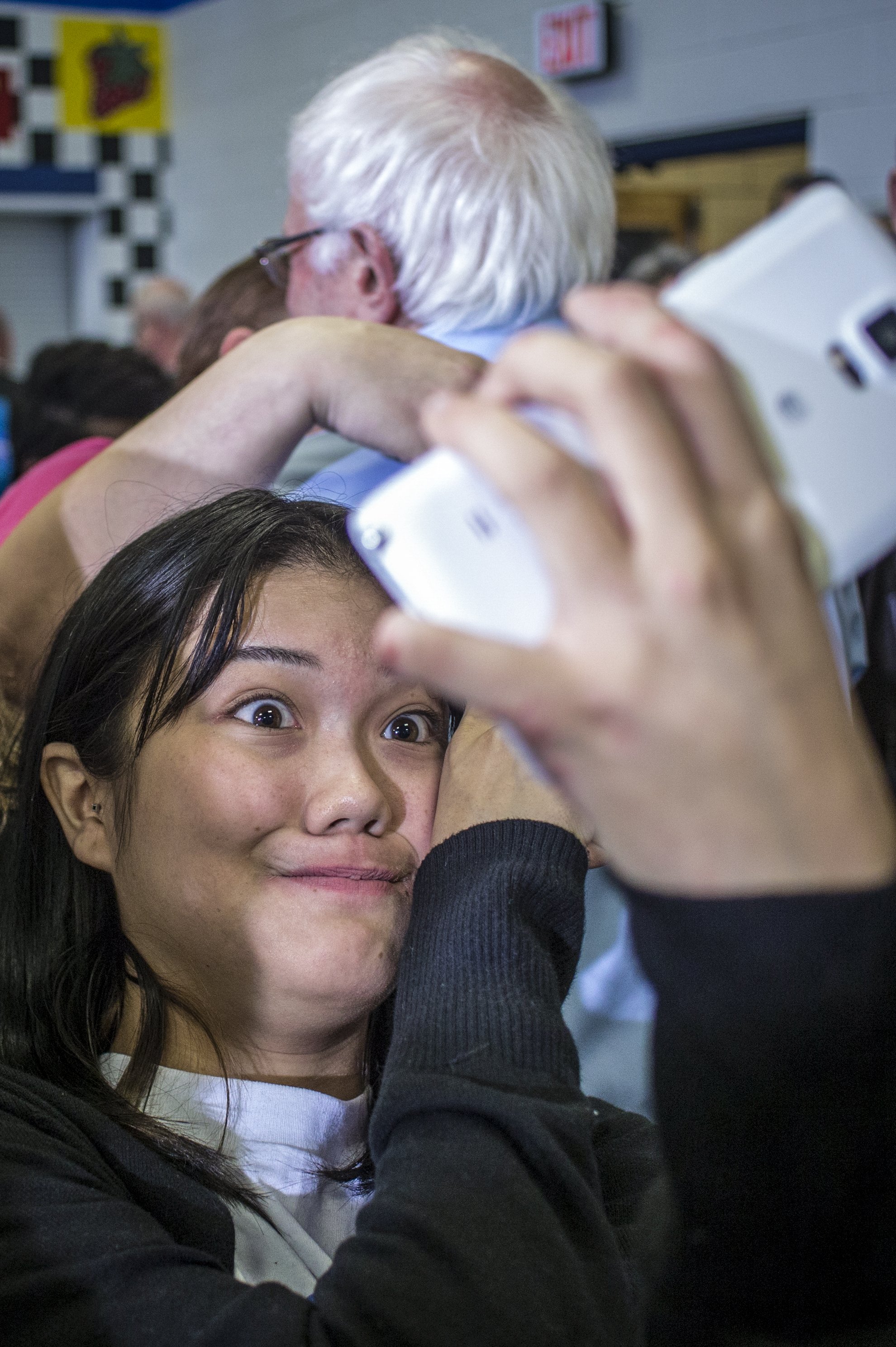 Linn-Mar junior Angel Trachta, 16, takes a selfie behind presidential hopeful Bernie Sanders after a campaign stop at Strawberry Hill Elementary in Anamosa, Iowa, Saturday, Dec. 12, 2015. Vermont Sen. Bernie Sanders made a campaign stop in Anamosa to hold a forum on racial justice and prison reform.