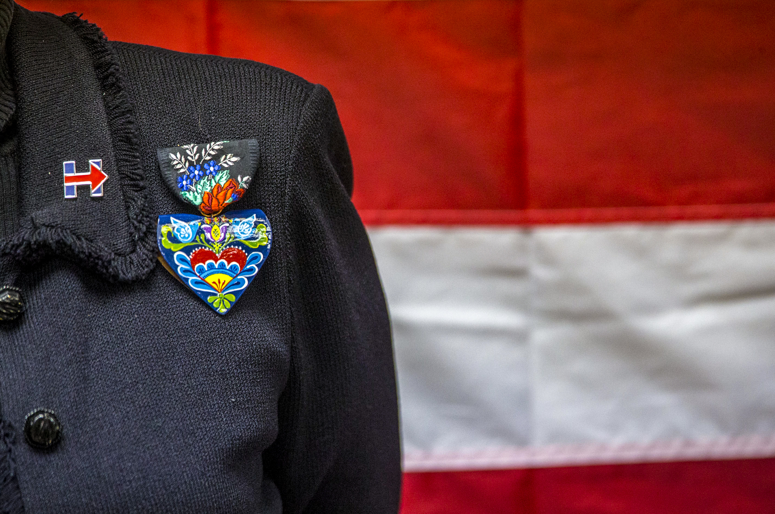 Former U.S. Secretary of State Madeleine Albright's famous pins are accompanied by a Hillary Clinton pin as she speaks at the Hillary for Iowa office in Cedar Rapids, Iowa, Sunday Jan. 17, 2016. Albright spoke to the crowded room about her close ties with the Clintons after serving as the first female U.S. Secretary of State while President Bill Clinton was in office. She used the opportunity to speak about presidential candidate Hillary Clinton's policies and to answer questions on her behalf.