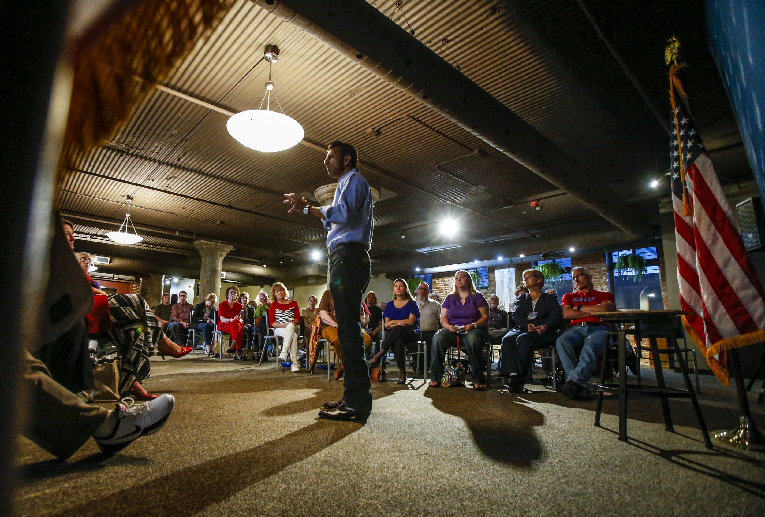 Presidential hopeful Bobby Jindal engages with members of the audience at the Shores Event Center in Cedar Rapids, Iowa, October 1, 2015. The Louisiana governor made a stop in Cedar Rapids to speak to a crowd of over 70 people and take questions from the crowd.