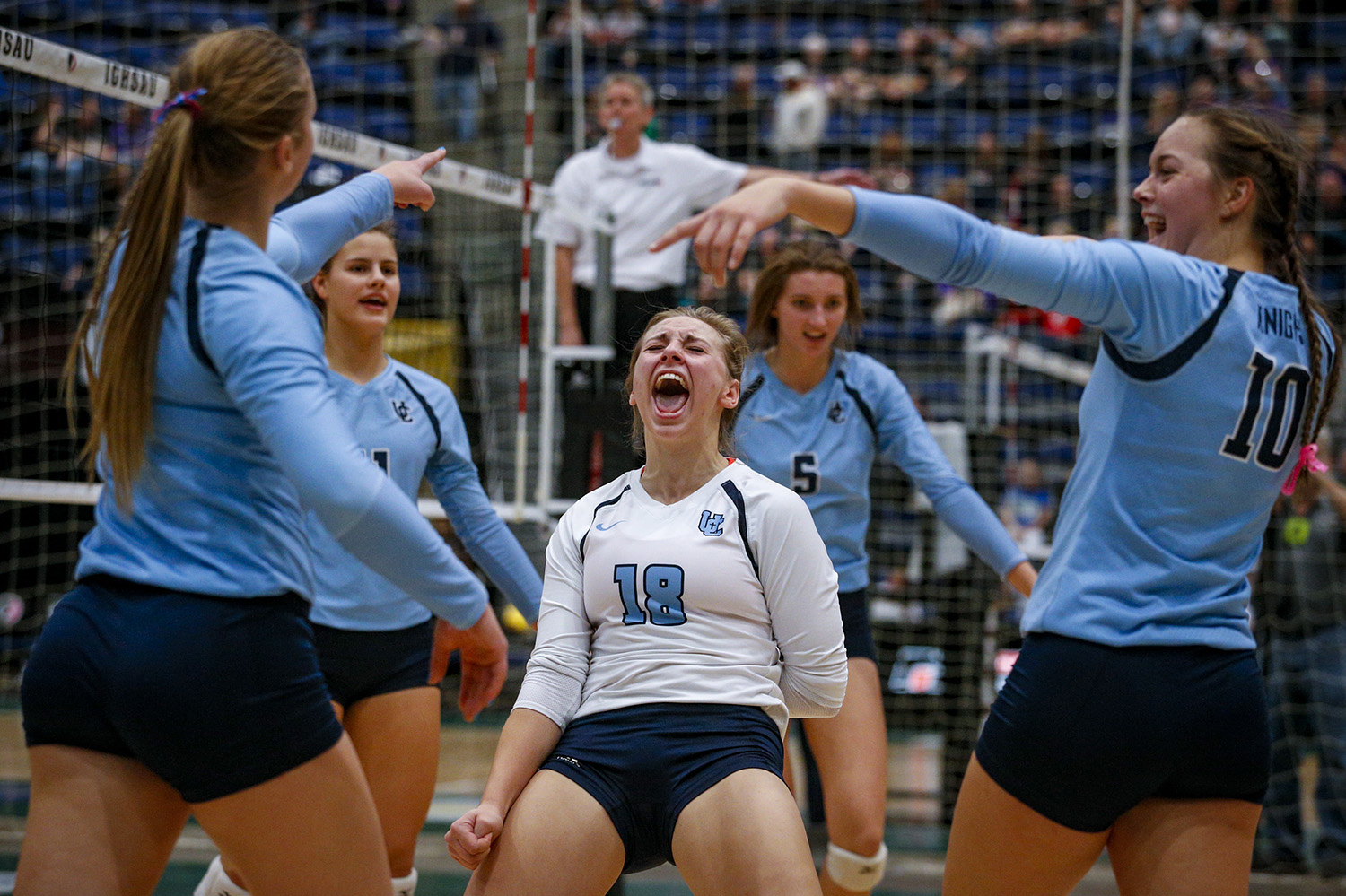 Unity Christian's Anna De Haan (18) celebrates a point with her teammates during Unity Christian vs Mediapolis Class 2A quarterfinal-round state volleyball action played Wednesday, Nov. 9, 2016, at the US Cellular Center in Cedar Rapids, Iowa.