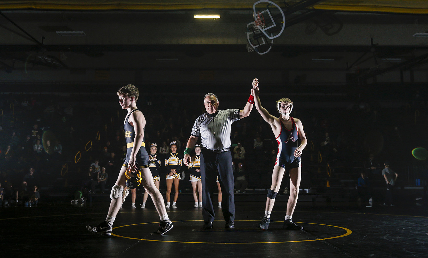 Bettendorf sophomore Voyen Adamson walks off the mat after losing his 126-weight match to Assumption senior Sean Casey during their dual at Bettendorf High School in Bettendorf, Iowa, on Wednesday, January 11, 2017. Bettendorf won the dual 36-35 on criteria after a tie.