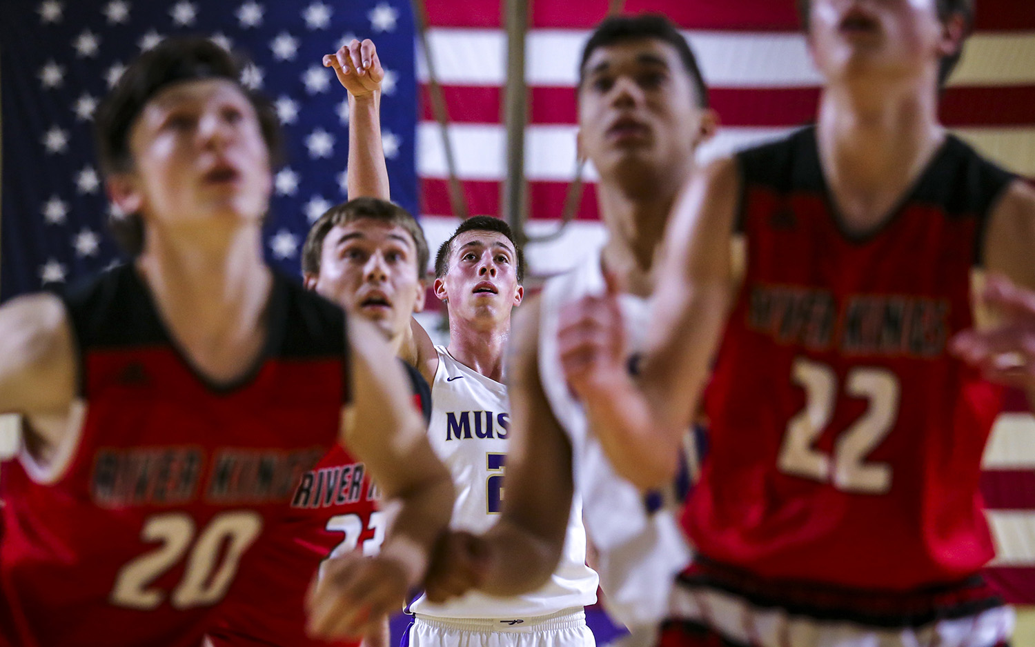 Muscatine's Joe Wieskamp (21) watches after shooting a free throw during the second quarter of their game at Muscatine High School in Muscatine, Iowa, on Tuesday, Jan. 23, 2018.Wieskamp finished with 31 points and eclipsed 2,000 points for his career in the Muskies' victory.