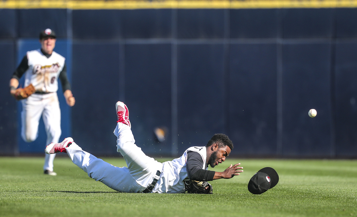 Quad-Cities River Bandits second baseman Marcos Almonte (1) loses his hold of a caught fly ball after diving and landing in the outfield during their game at Modern Woodmen Park in Davenport, Iowa, on Sunday, April 29, 2018.