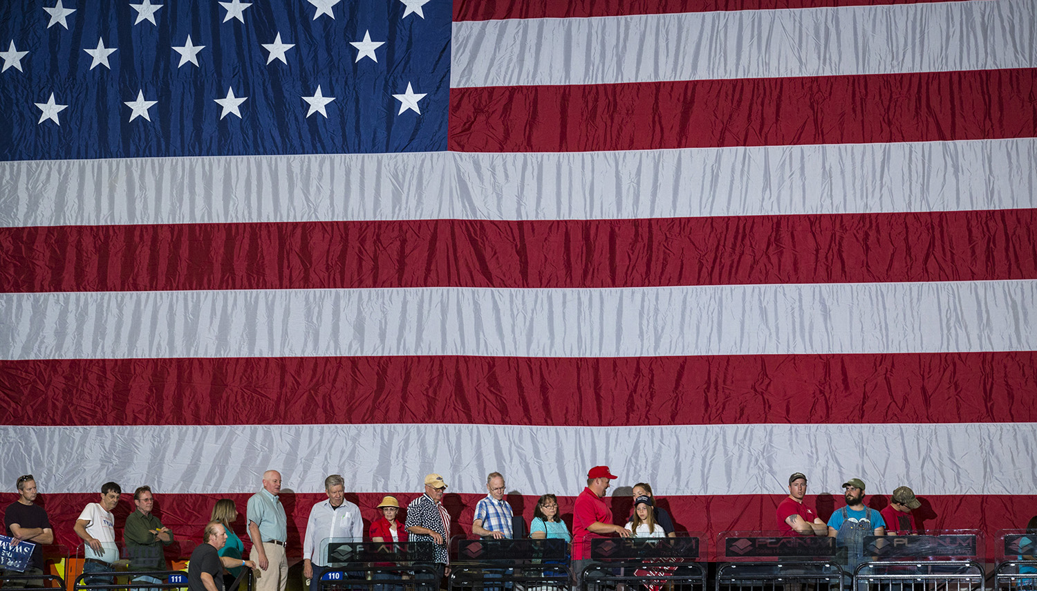 Supporters file in to hear President Donald Trump speak at the U.S. Cellular Center in Cedar Rapids, Iowa, Wednesday, June 21, 2017.