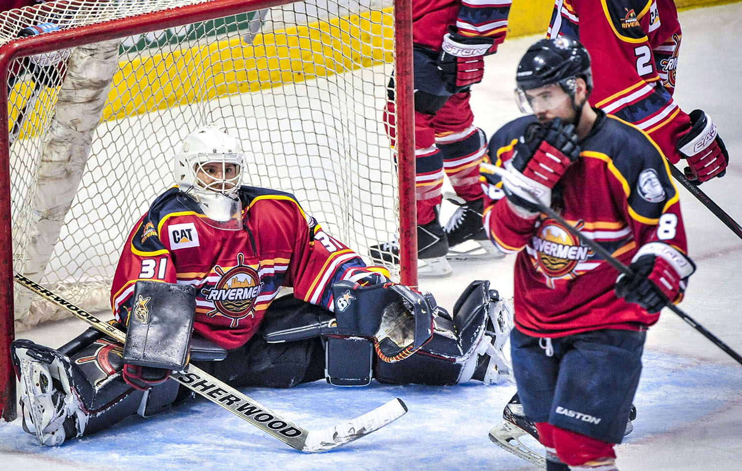 Rivermen goaltender Kyle Rank (31) and teammate Steve Morra (88) react to an Ice Flyers goal during the second period of their game at Carver arena in Peoria, Illinois, Saturday night. The Ice Flyers defeated the Rivermen 2-1.