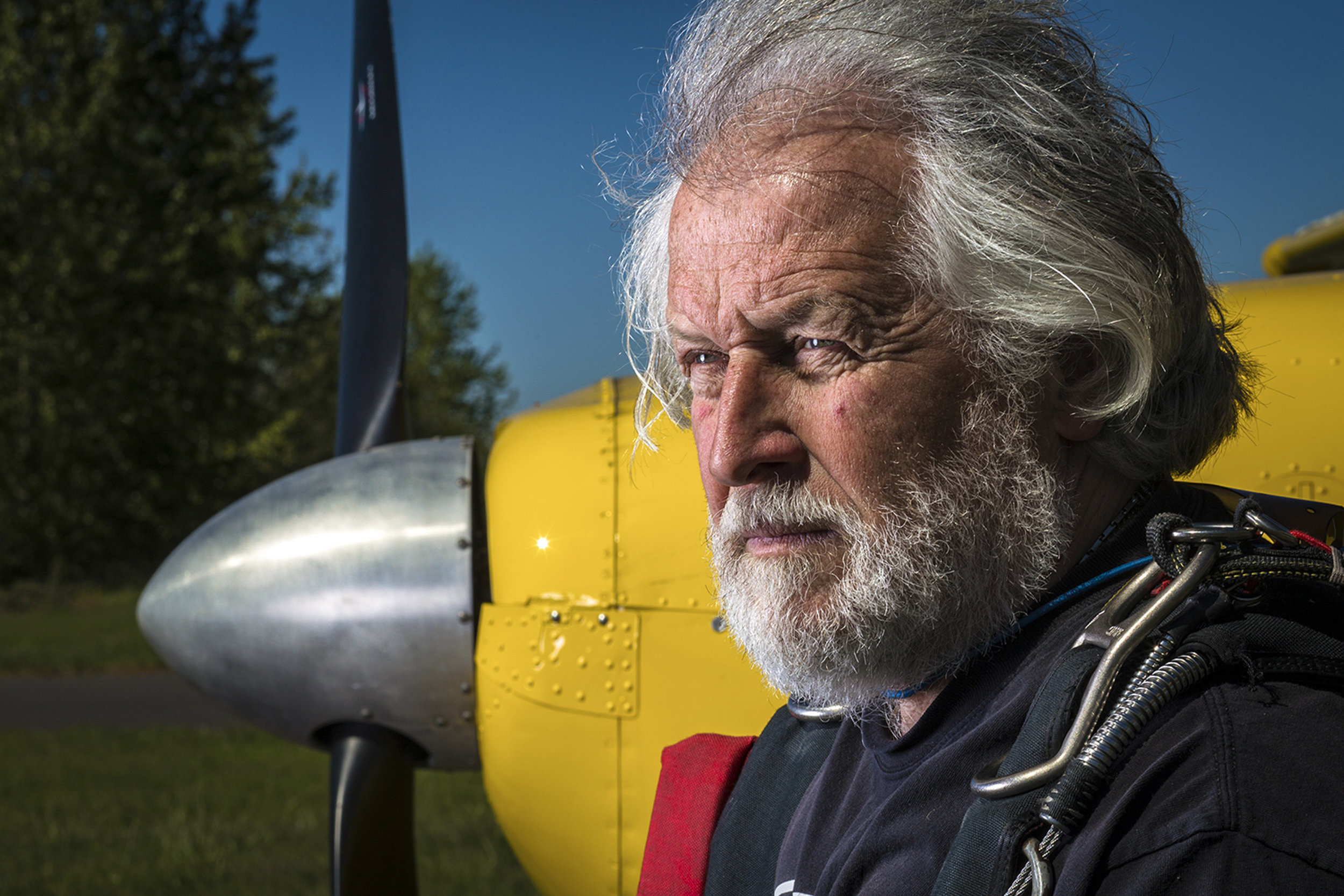 Owner of Eugene Skydivers, Urban Moore stands in front of one of the three '50s Cessnas his company owns at the Creswell Airport in Oregon, April 17, 2015. At age 65, Moore still skydives multiple times a day during the jump season and teaches new jumpers looking to get their licenses.