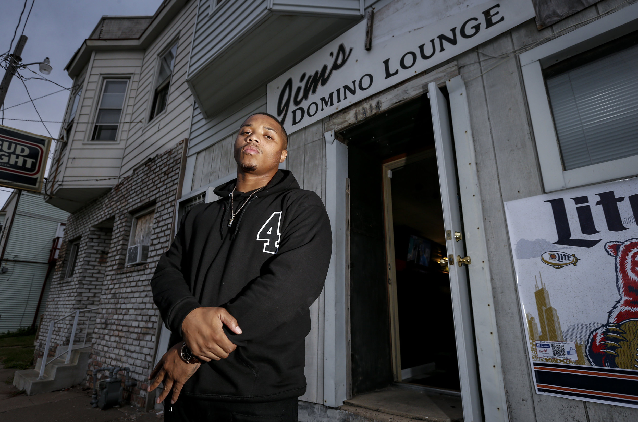 Torrian Ball poses for a photo in front of Jim's Domino Lounge on 13th Street in East Moline, Wednesday, October 19, 2016. The lounge was where Ball performed for the first time with a simple setup in the corner for a small crowd.