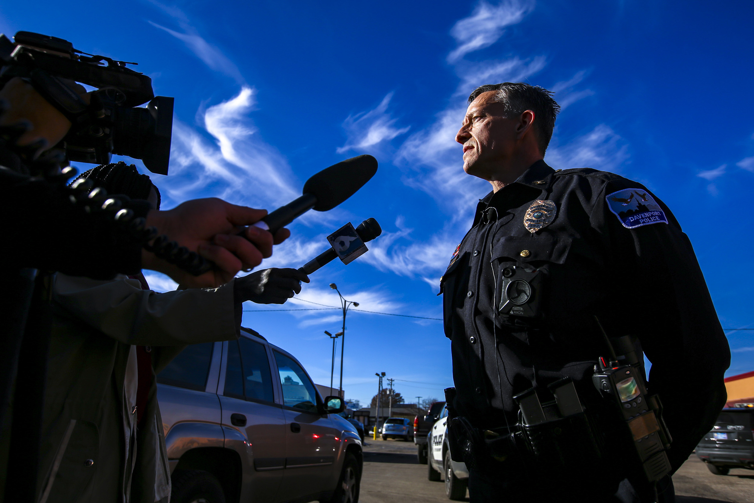 Davenport Chief of Police Paul Sikorski takes questions from members of the media during a brief news conference at the scene of a shooting injuring one man at the Dollar General in Davenport, Tuesday, Dec. 18, 2018.