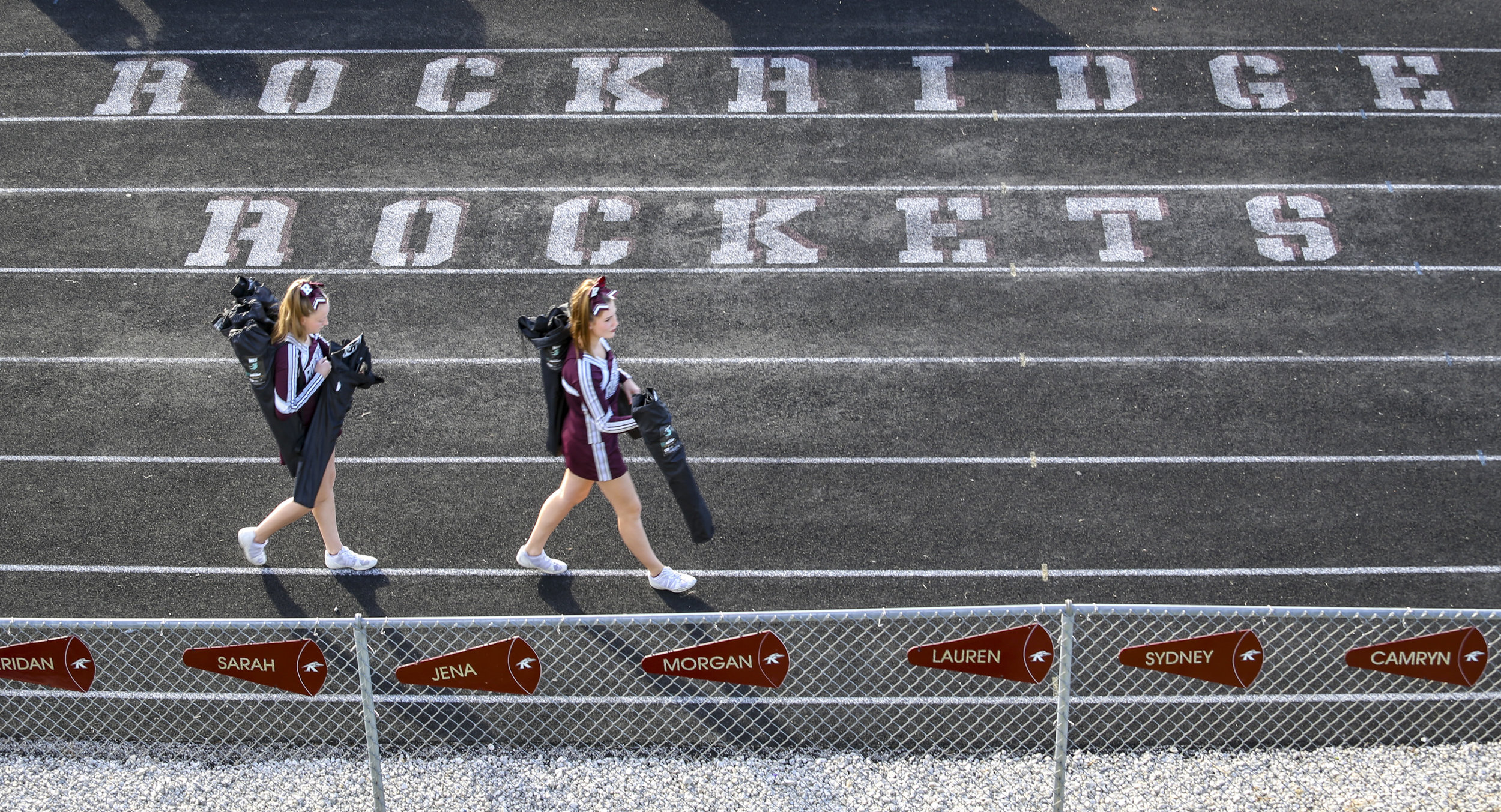 Rockridge cheerleaders take their folding chairs out to the side of the football field before the game at Rockridge High School in Edginton, Friday, October 20, 2017.