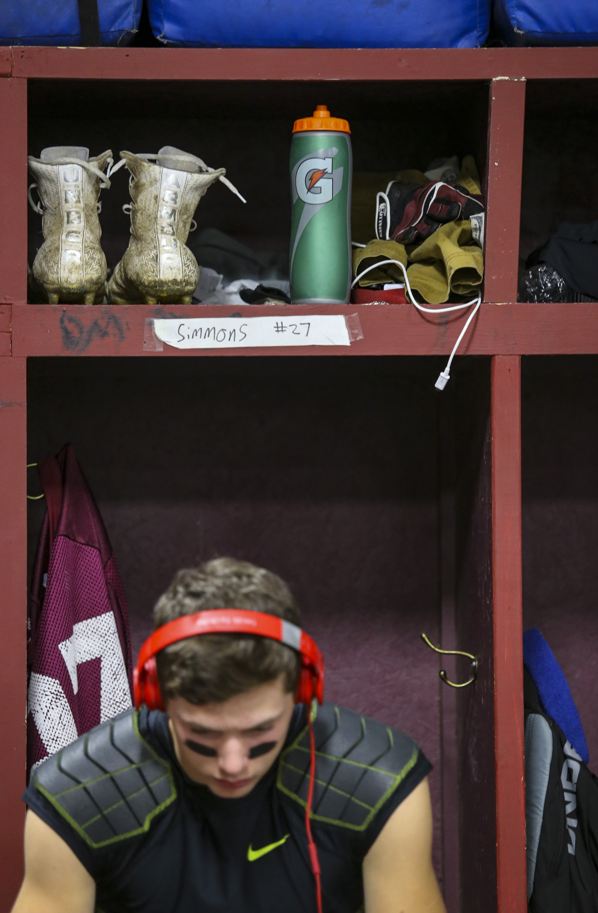 Rockridge varsity player Will Simmons (27) listens to music in the locker room before their game at Rockridge High School in Edginton, Friday, October 20, 2017.