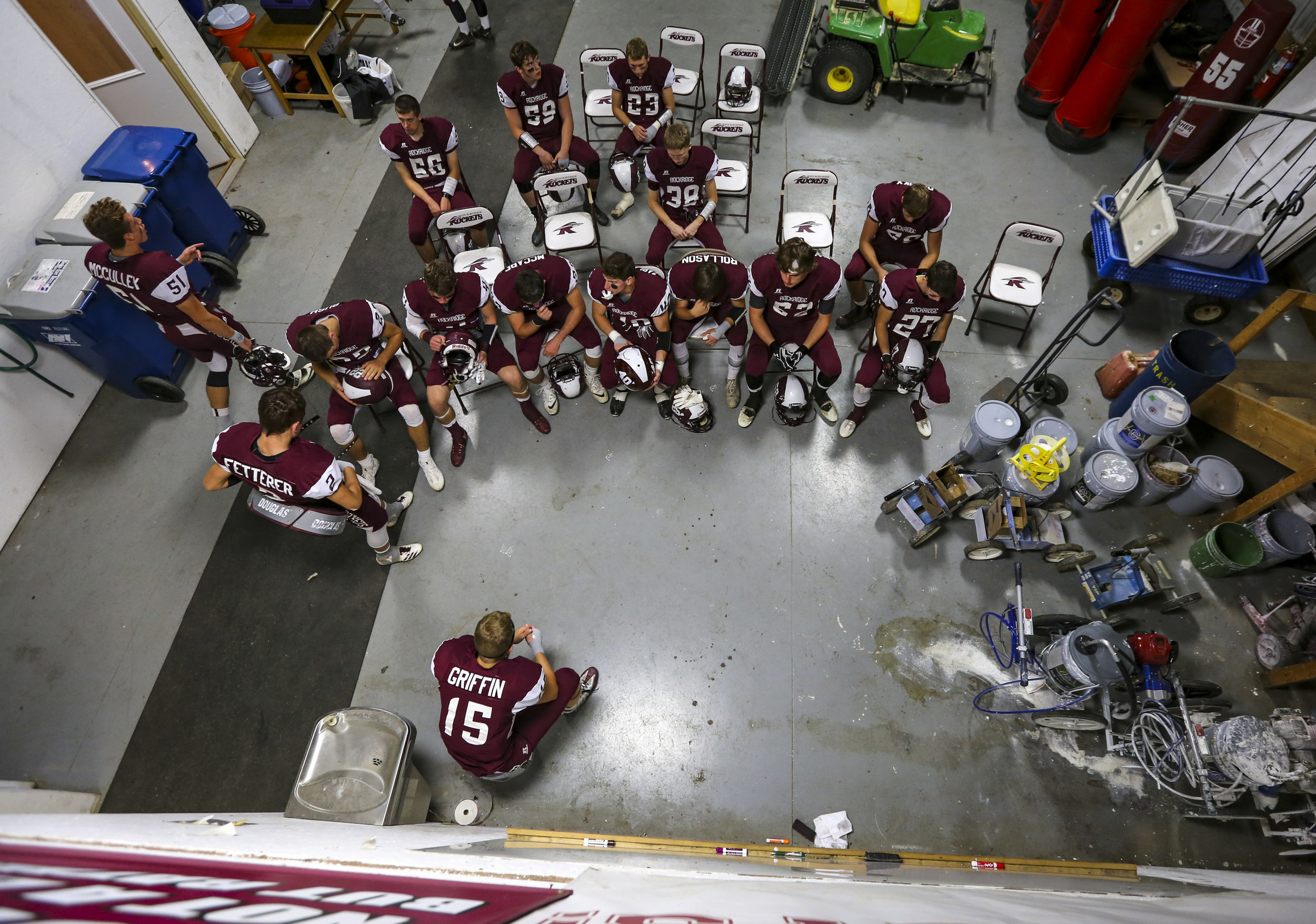Rockridge players take a moment together in the locker room before their game at Rockridge High School in Edginton, Friday, October 20, 2017.