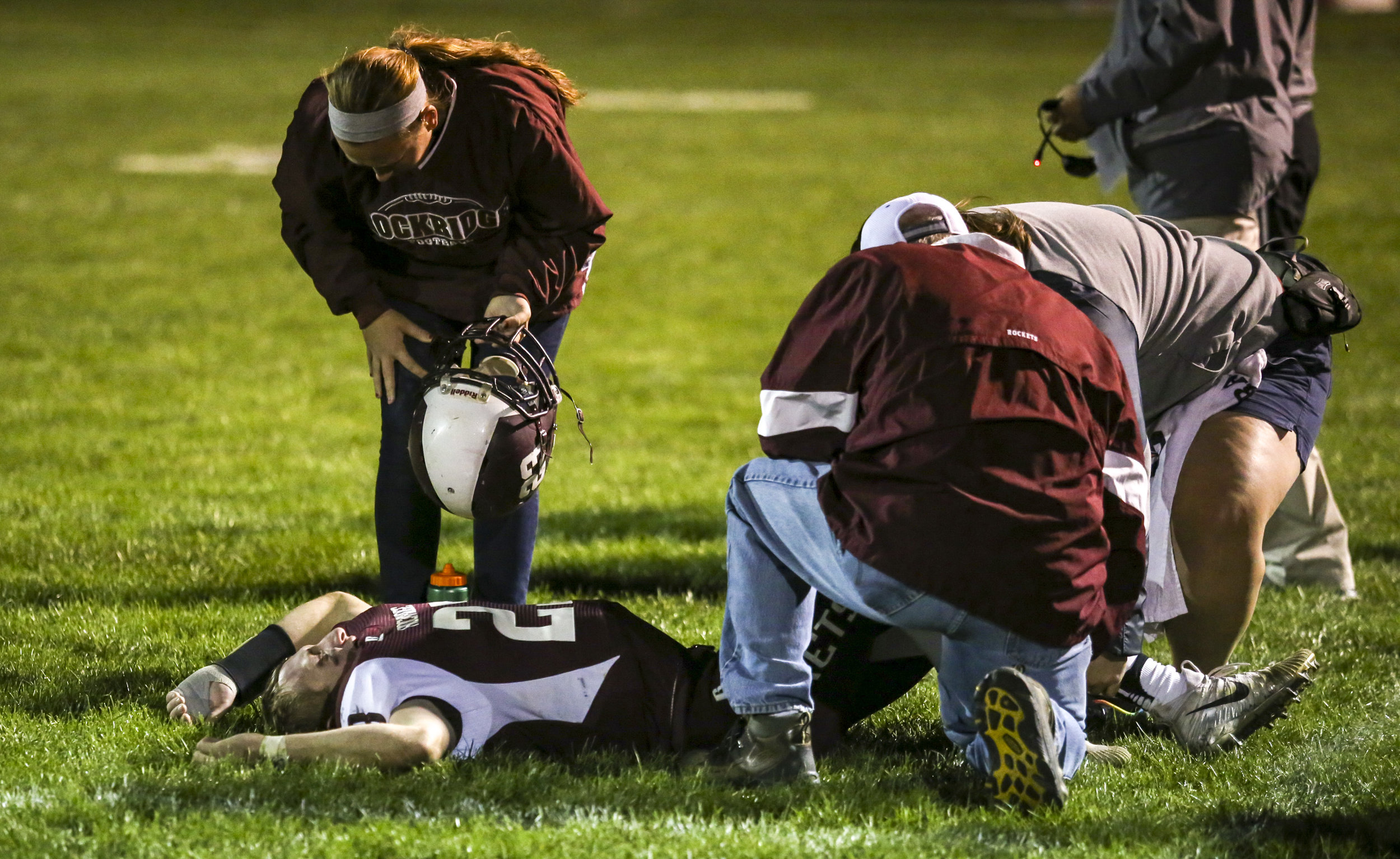 Rockridge's Nathan Parchert (23) lays on the field with na injury that kept him out of the rest of the game during the fourth quarter of their game at Rockridge High School in Edginton, Friday, October 20, 2017.