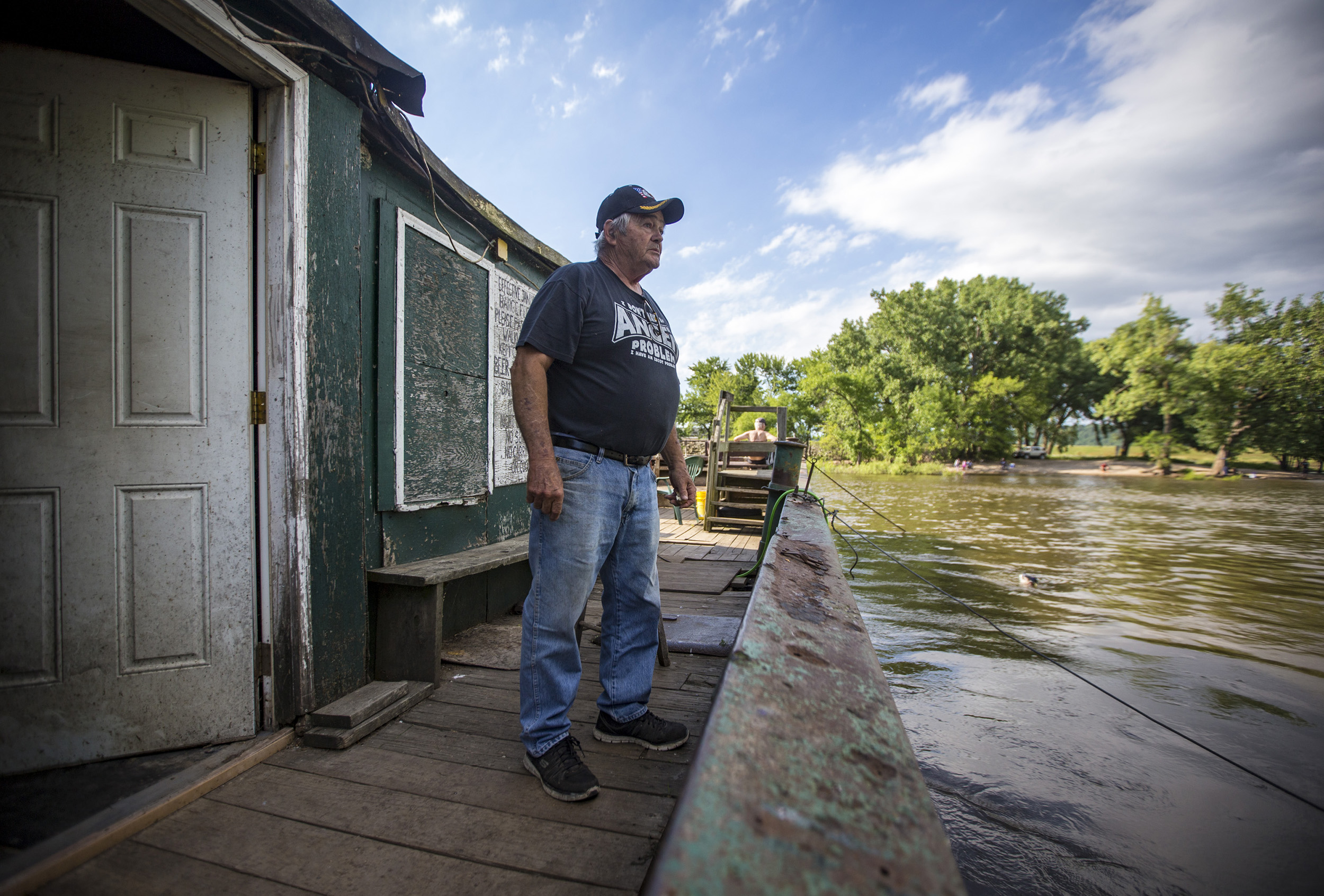 Carl Hanson, owner of the Eagle Point Fishing Barge looks out to shore watching a pair of ducks in the water in Hazel Green, Wisconsin, Tuesday, June 20, 2017. Hanson has owned the barge for 23 years which started life in 1916 and was previously used to haul horses for the calvary in World War I but has been used for fishing since 1955. Hanson had plans in the works to replace the barge with a newer one before the end of summer.