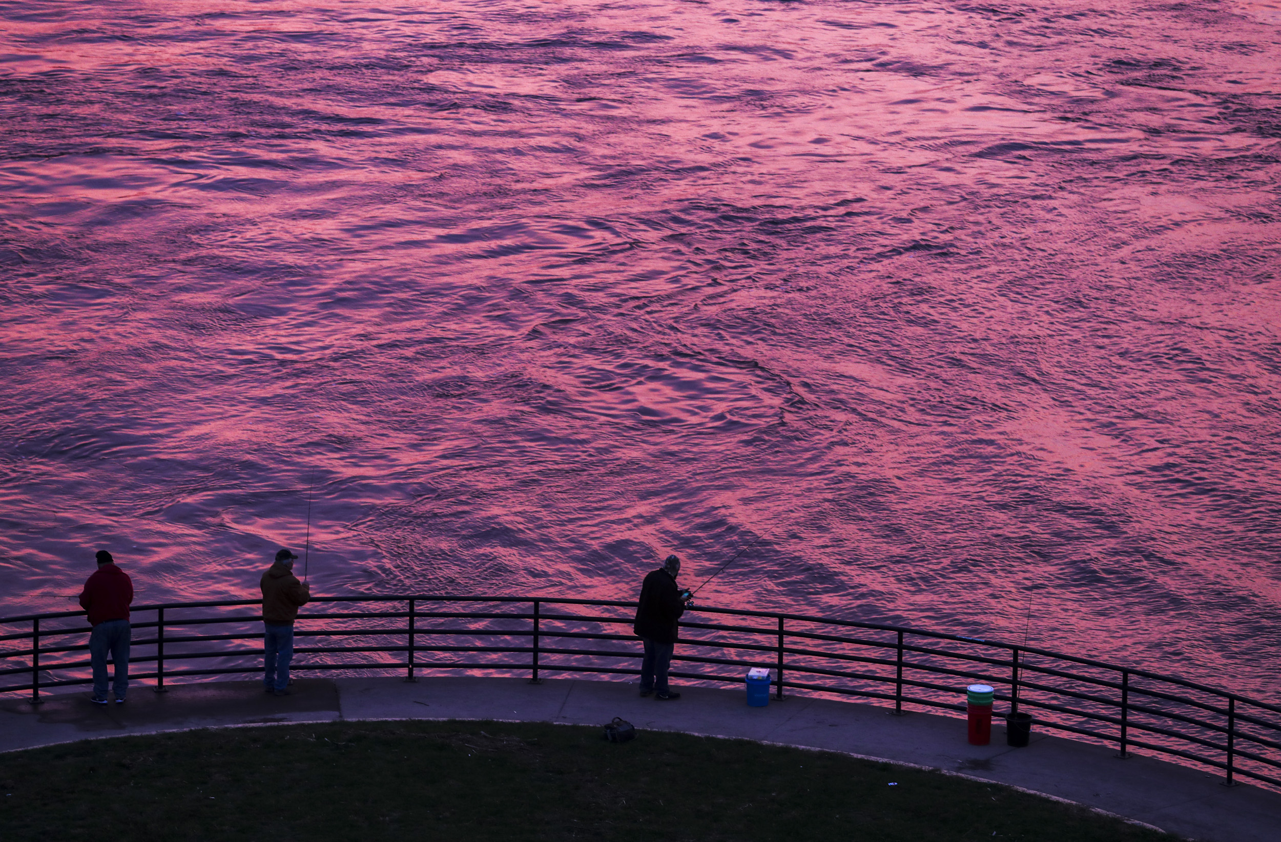 Fishermen cast their lines in the Mississippi River as the sun sets in Davenport, Thursday, Nov. 1, 2018.