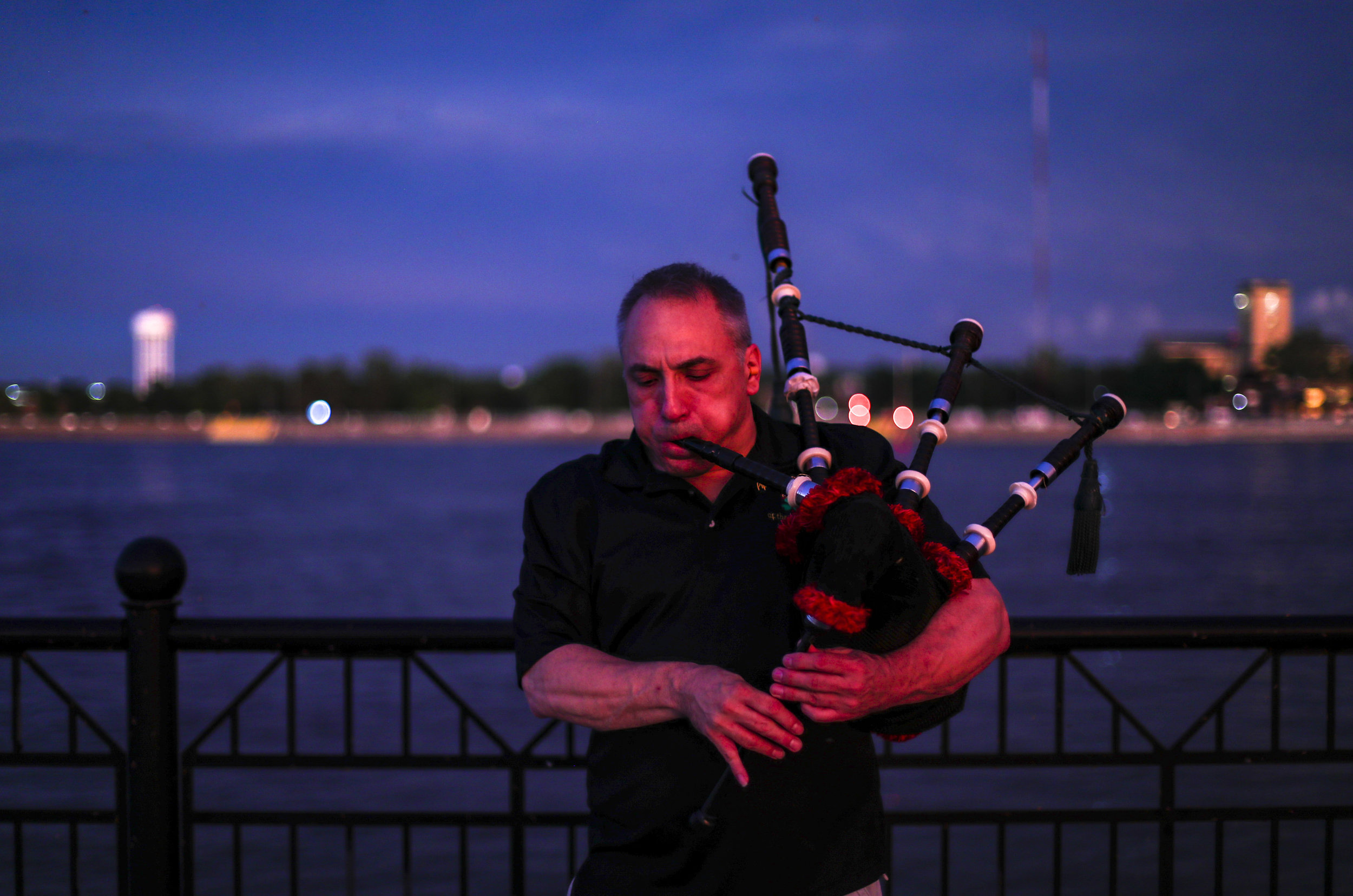 David Cohen of Davenport takes to the Mississippi riverfront to practice playing his bagpipes as the sun sets in Davenport, Tuesday, June 25, 2019.
