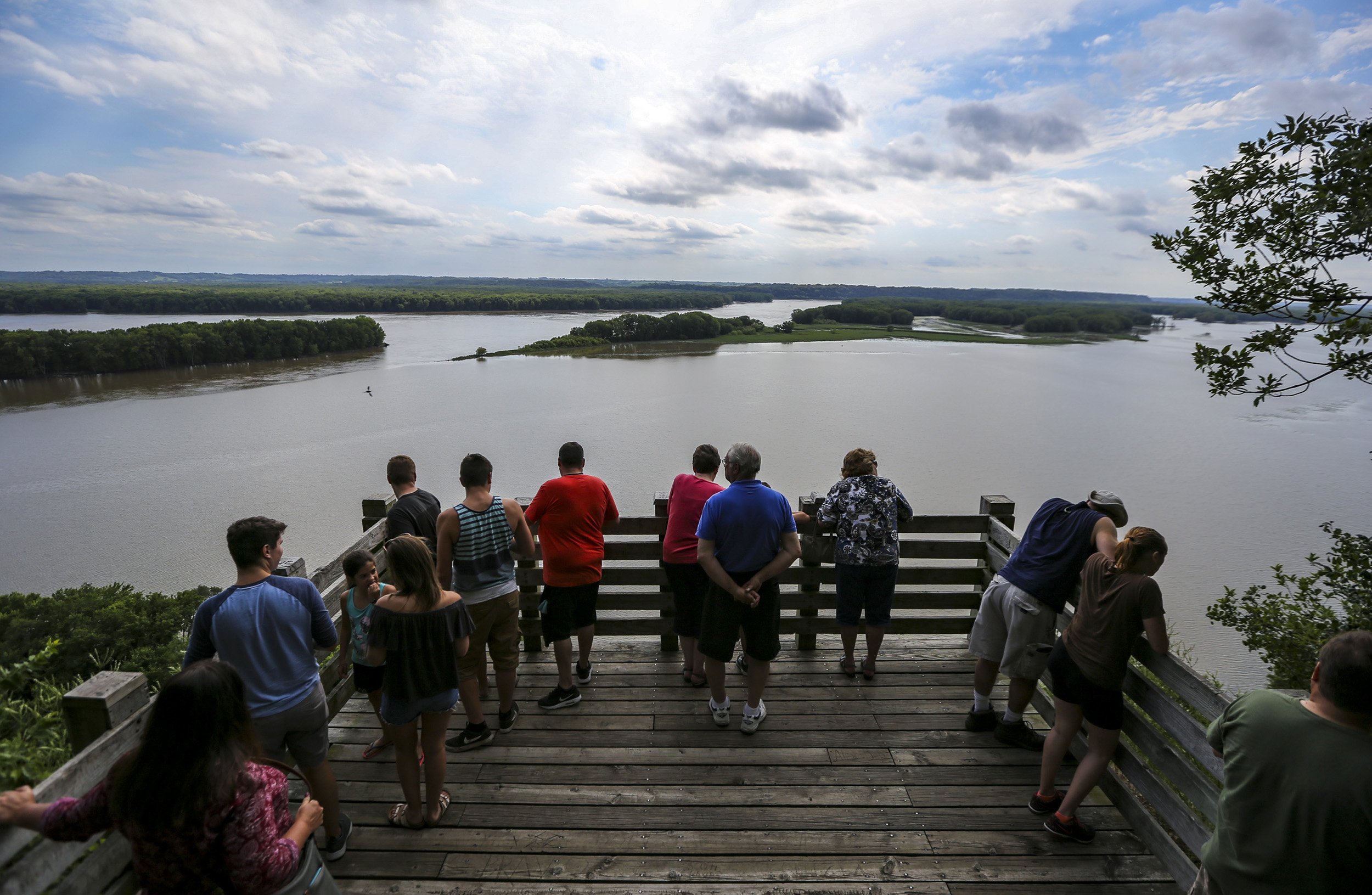 Park-goers take in the view from Lookout Point at Mississippi Palisades State Park in Savanna, Illinois, Saturday, July 15, 2017.