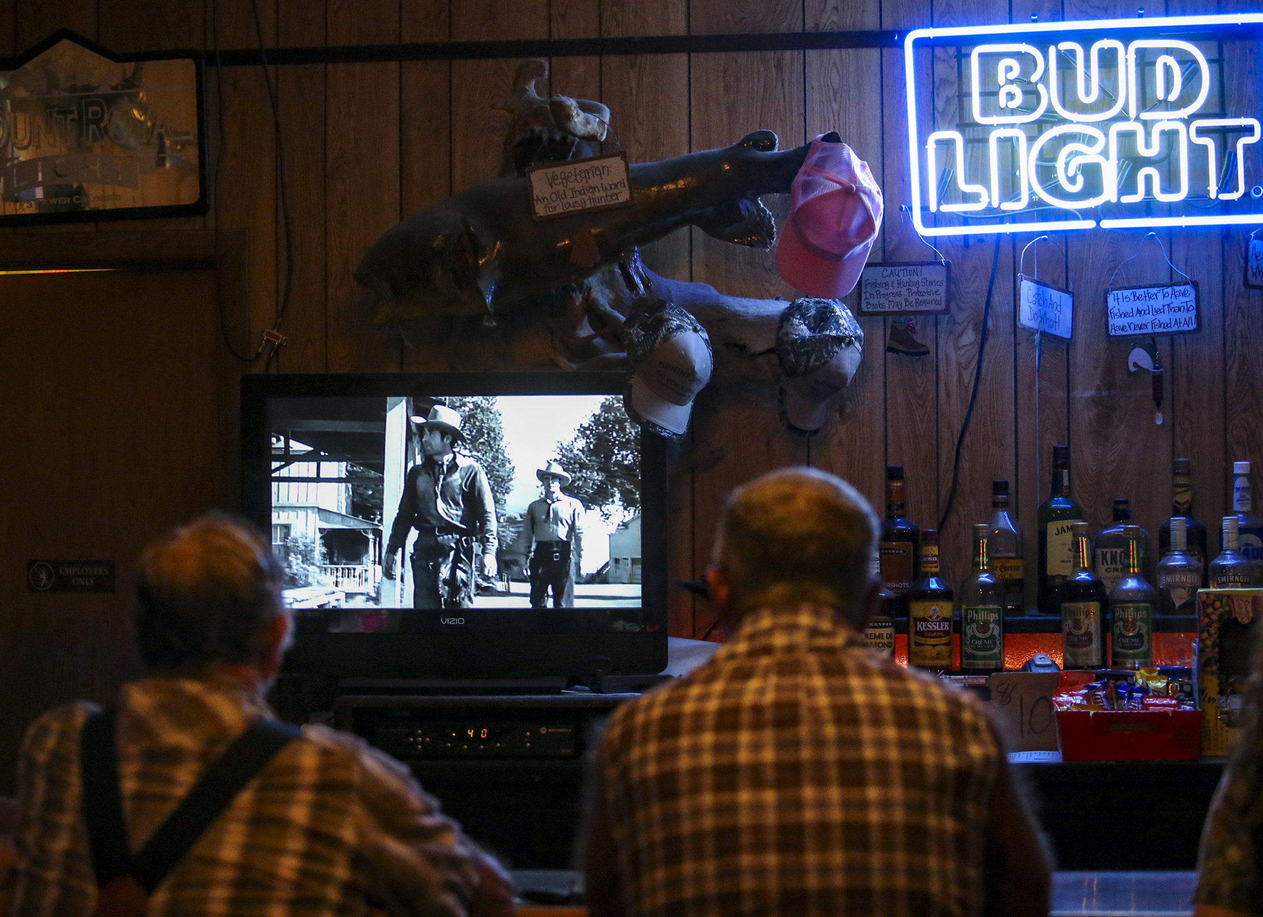 Old westerns play behind the bar at the Bright Spot in De Soto, Wisconsin, Tuesday, June 6, 2017. James Boardman has owned the restaurant since 1979, but it has stood in the same location under the same name since 1933.