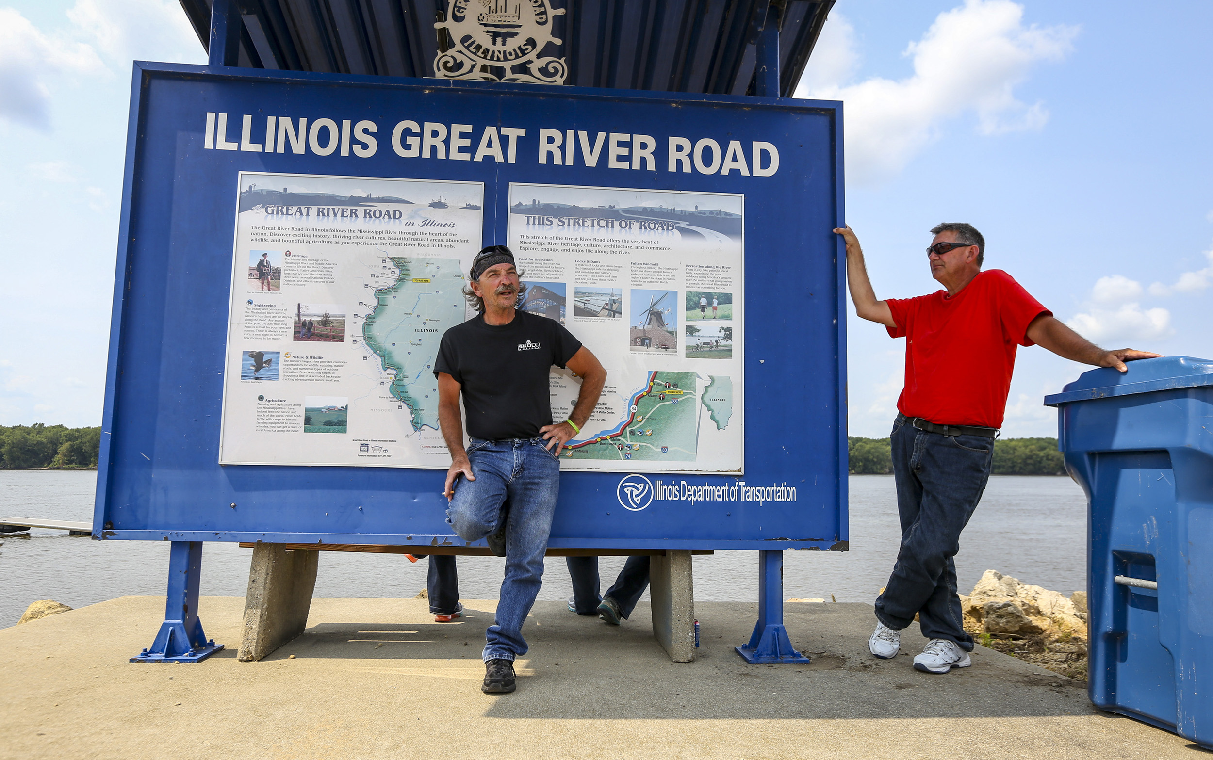 Ken Streitmatter, left and Marty Cantwell of Toulon take a rest together at the Albany boat landing in Albany, Illinois, Wednesday, August 2, 2017. The two couples had spent the last five days riding the Illinois Great River Road and were on their way home. They plan a motorcycle trip each summer and picked the road this summer after nearly a decade riding together.