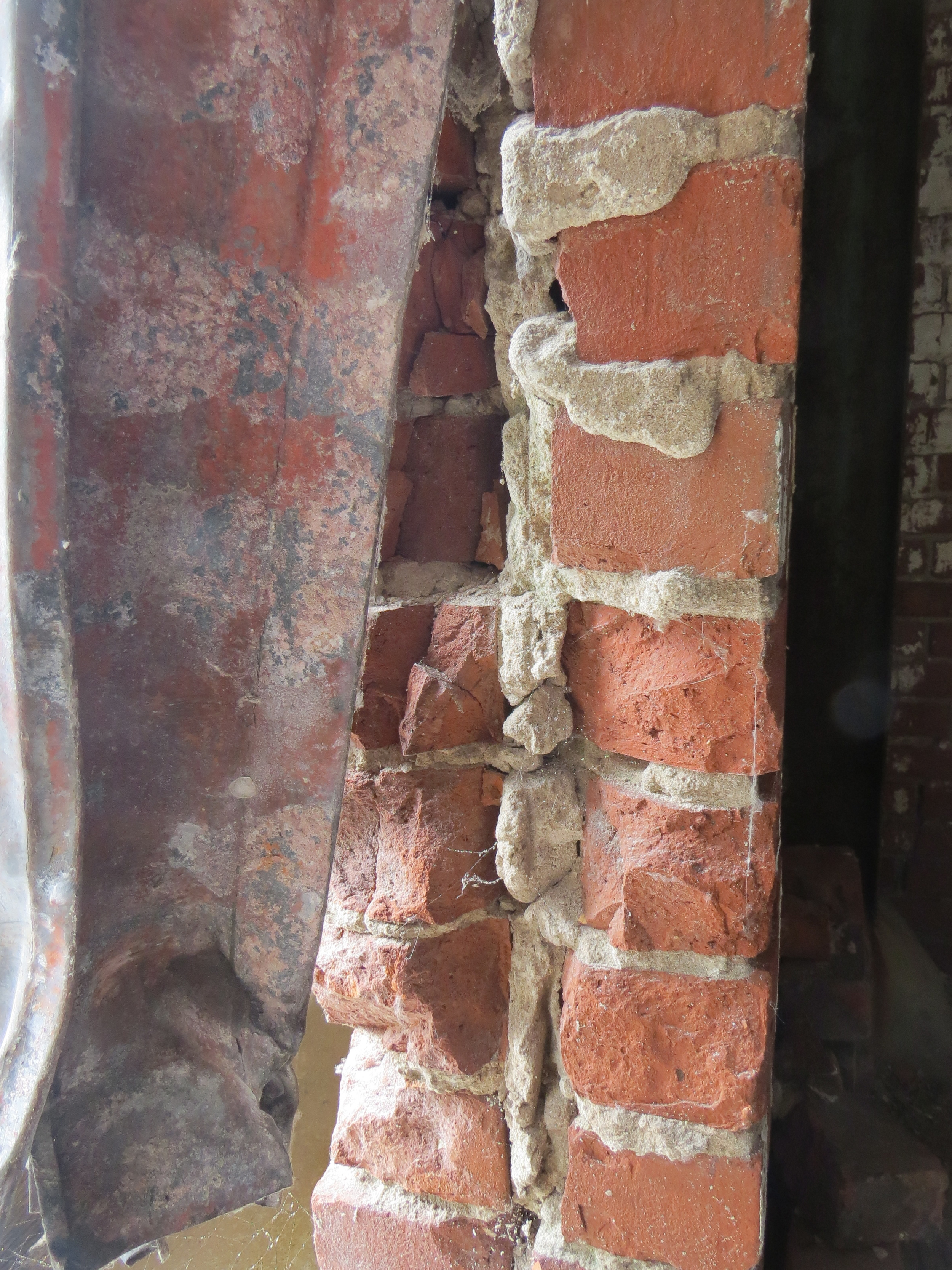 another masonry section revealed in a window opening