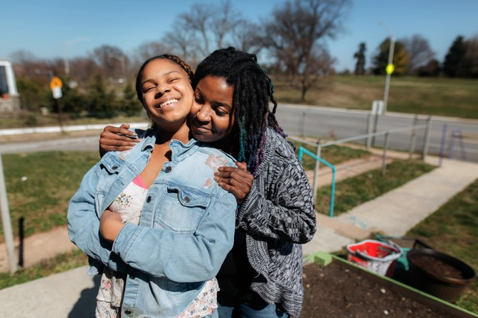 April VaiVai hugs her daughter Cameren Queen at their home in Baltimore, Maryland for The Atlantic - 2018