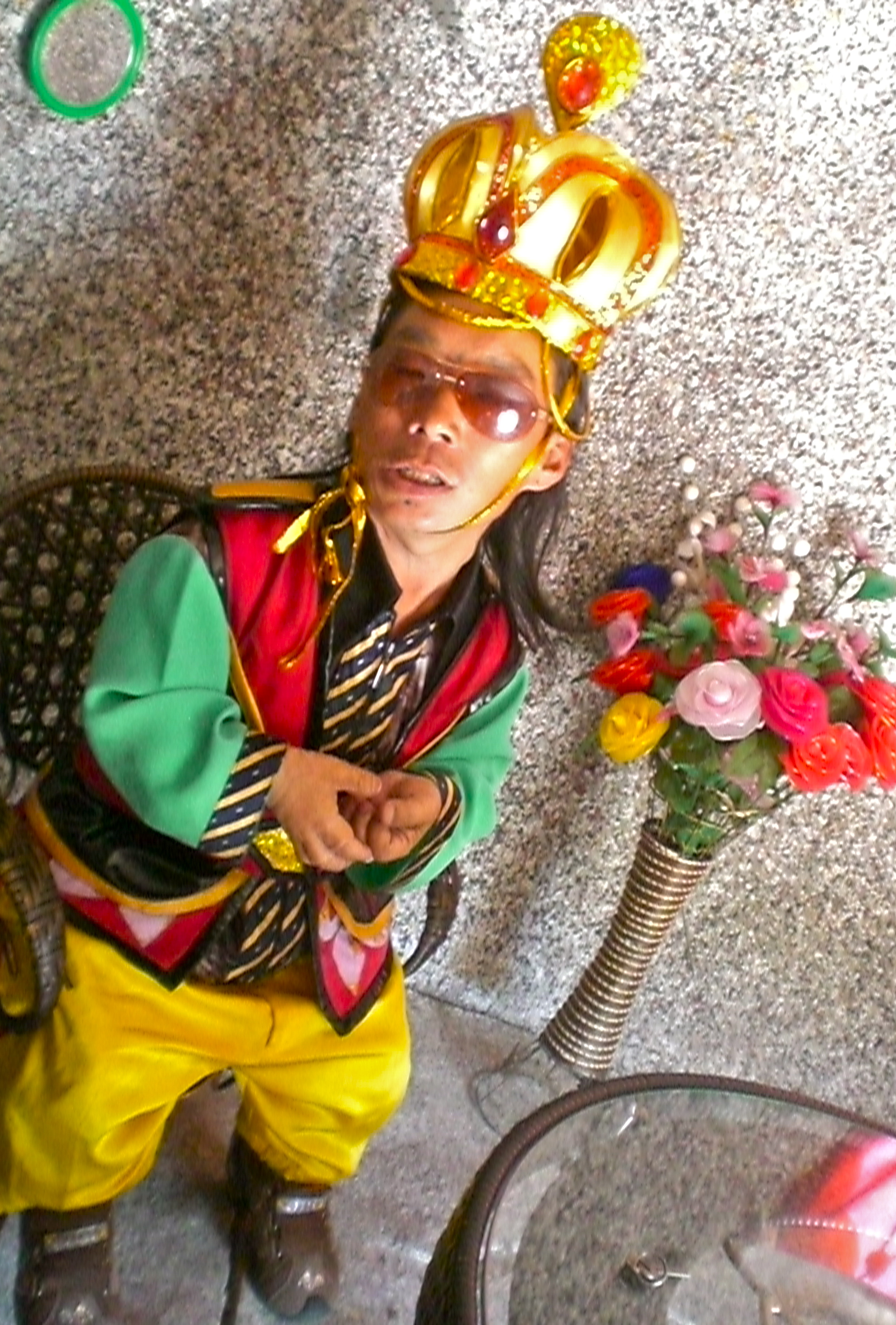 Wu Zi Ming, dressed for his role as king of the Kingdom of the Dwarfs in his palace.  (C) Remko Tanis