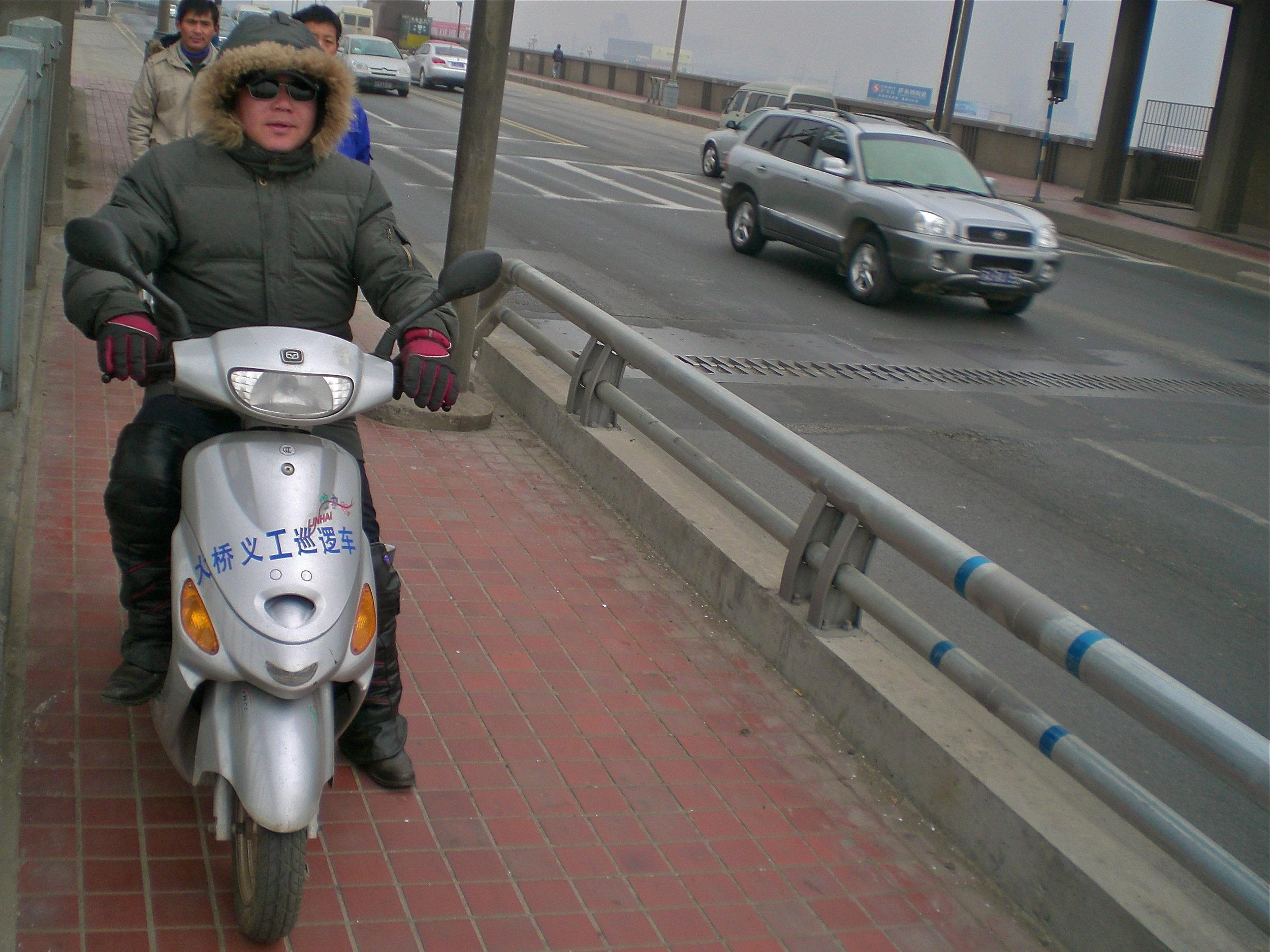 On suicide patrol: Chen Si on the Yangtze River Bridge in Nanjing, China. (C) Remko Tanis
