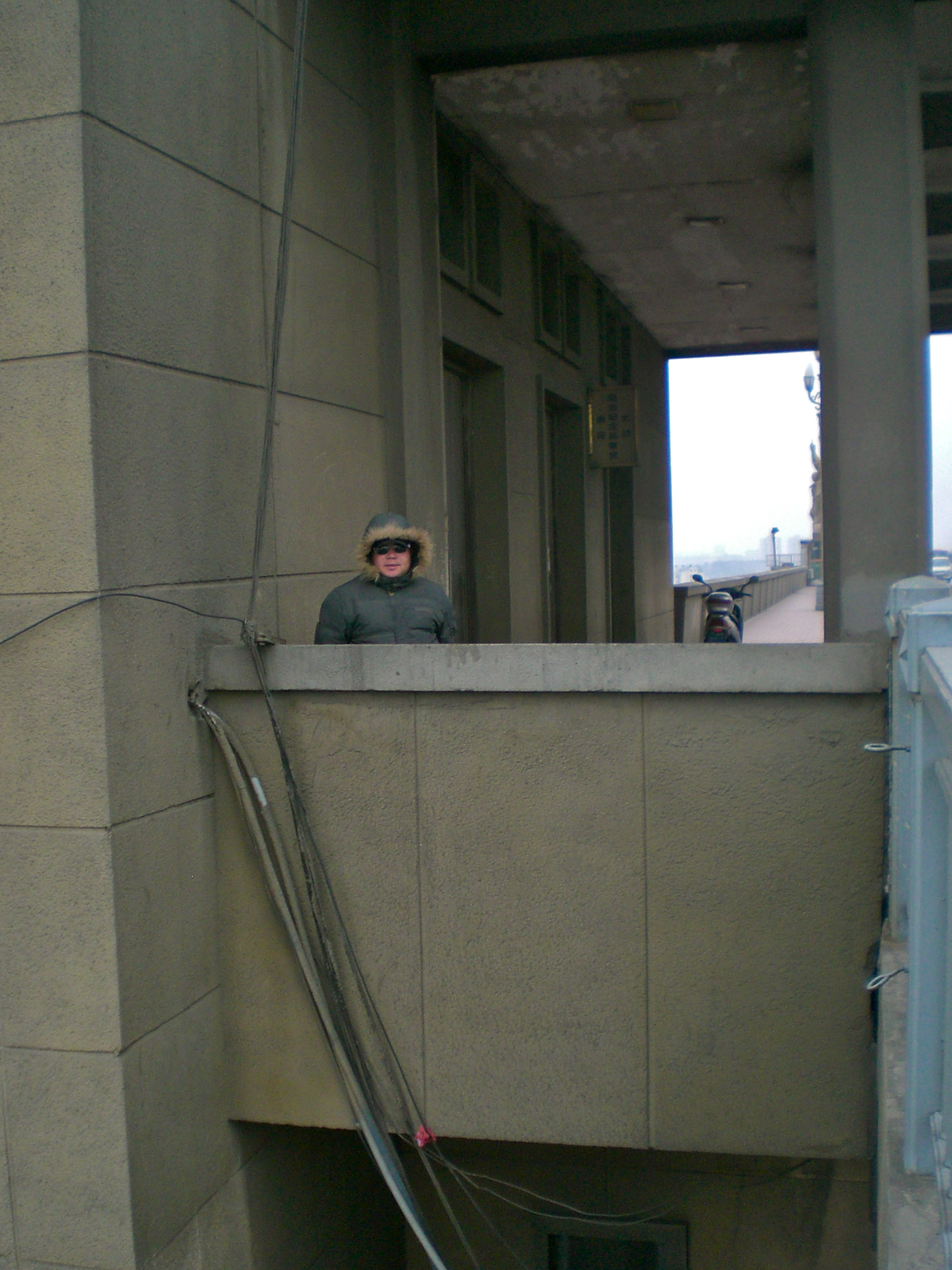 Chen Si on the Yangtze River Bridge in Nanjing, China. (C) Remko Tanis