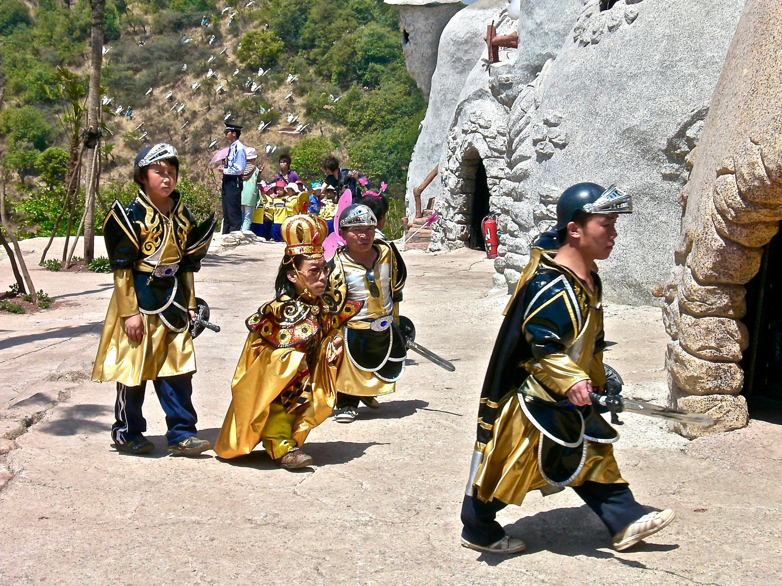 - In an amusement park in southern China, visitors pay to watch short adults dress up, sing and dance.
